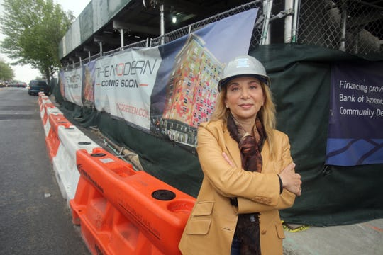 Rella Fogliano, founder and CEO of the MacQuesten Companies, outside an apartment building construction site in Mount Vernon May 13, 2016.