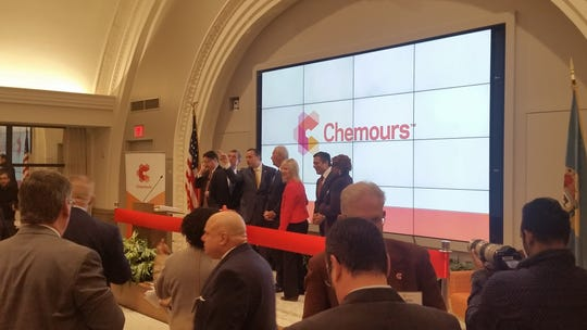 Chemours CEO Mark Vergnano (center) points at something in a newly remodeled event space at the DuPont Building. Among those looking on are Gov. John Carney and Wilmington Mayor Mike Purzycki.