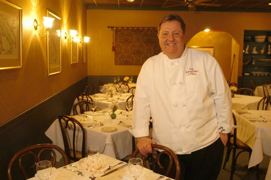 -  In this file photo, chef-owner Anthony Stella poses in the middle of his intimate dining room at L'Osteria, where he serves his homemade pasta based on old family recipes