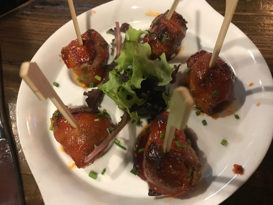 Beef and bacon lollipops at the Stone Balloon Ale House are little bites of meatloaf, wrapped in bacon and brushed with tomato Dijon brown sugar dipping sauce.