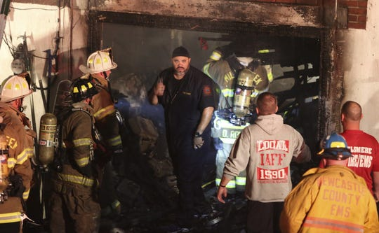 Then-Wilmington Fire Chief Anthony Goode works with other firefighters at a rowhome fire on Lakeview Road after a fire was reported