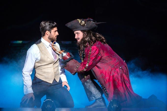 "Conor McGriffin, right, as Captain Hook in ""Finding Neverland,"" which will be at the Playhouse on Rodney Square Feb. 7- 10."
