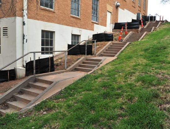 Pedestrian cones mark a hazardous walkway on the southwest side of the Wichita Falls Memorial Auditorium building.