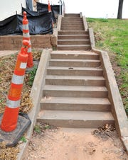 Pedestrian cones mark a hazardous walkway on the southwest side of the Wichita Falls Memorial Auditorium building.