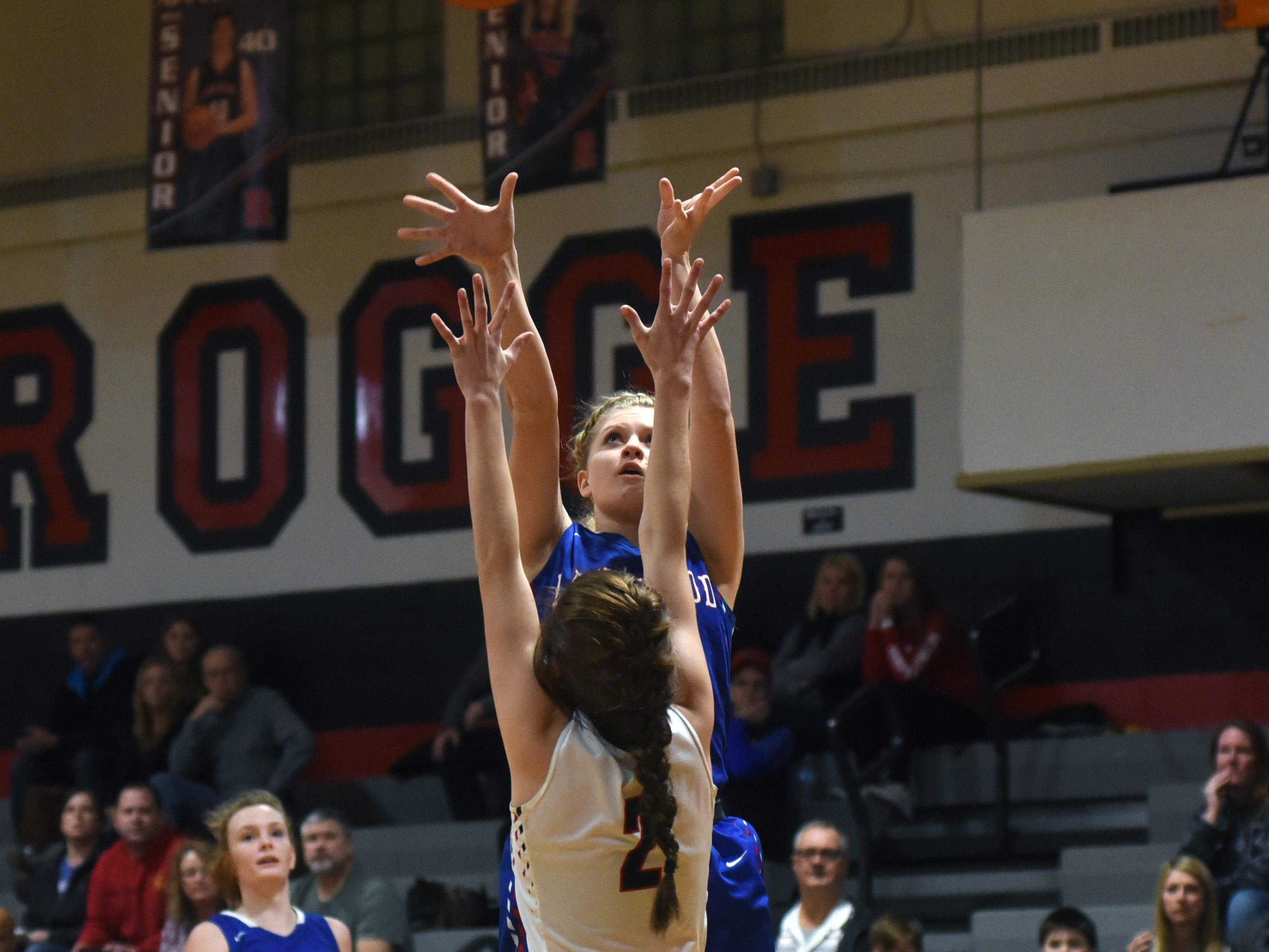 Camryn Martindale, of Lakewood, shoots over Rosecrans' Kailey Zemba on Monday night at Rogge Gymnasium.