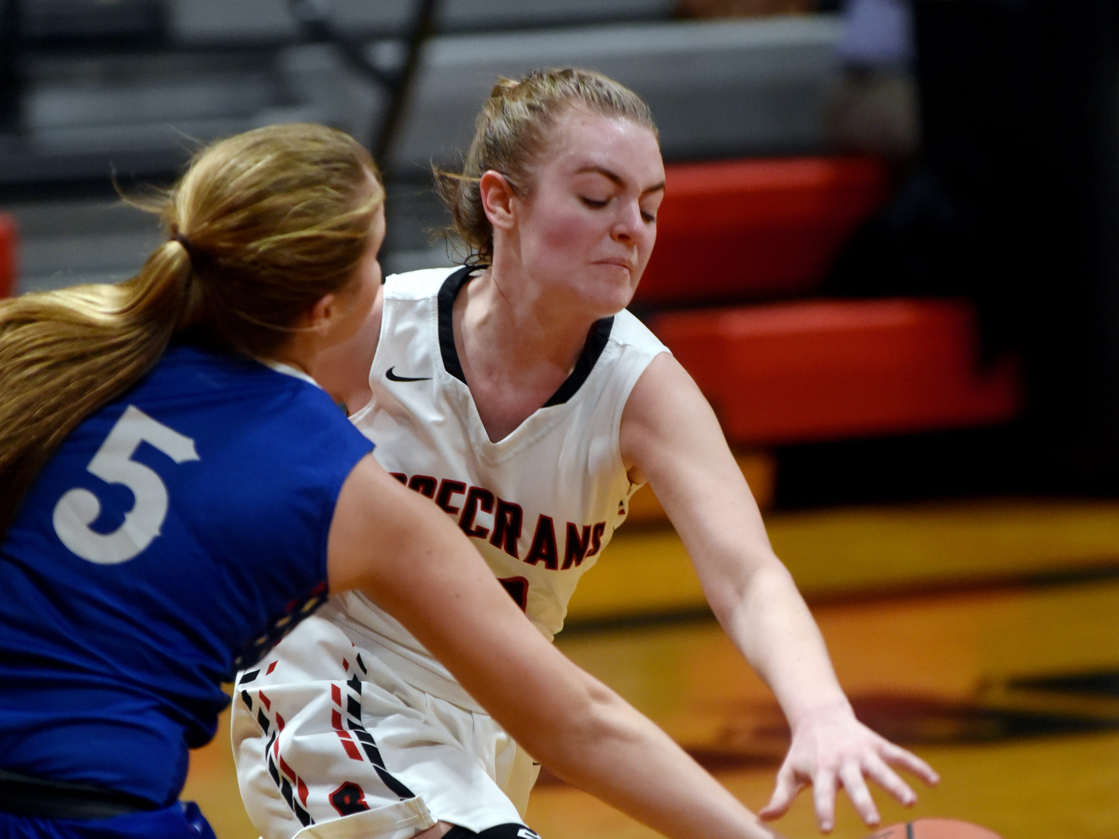 Rosecrans' Tessa Littick reaches for a loose ball against Lakewood on Monday night at Rogge Gymnasium.