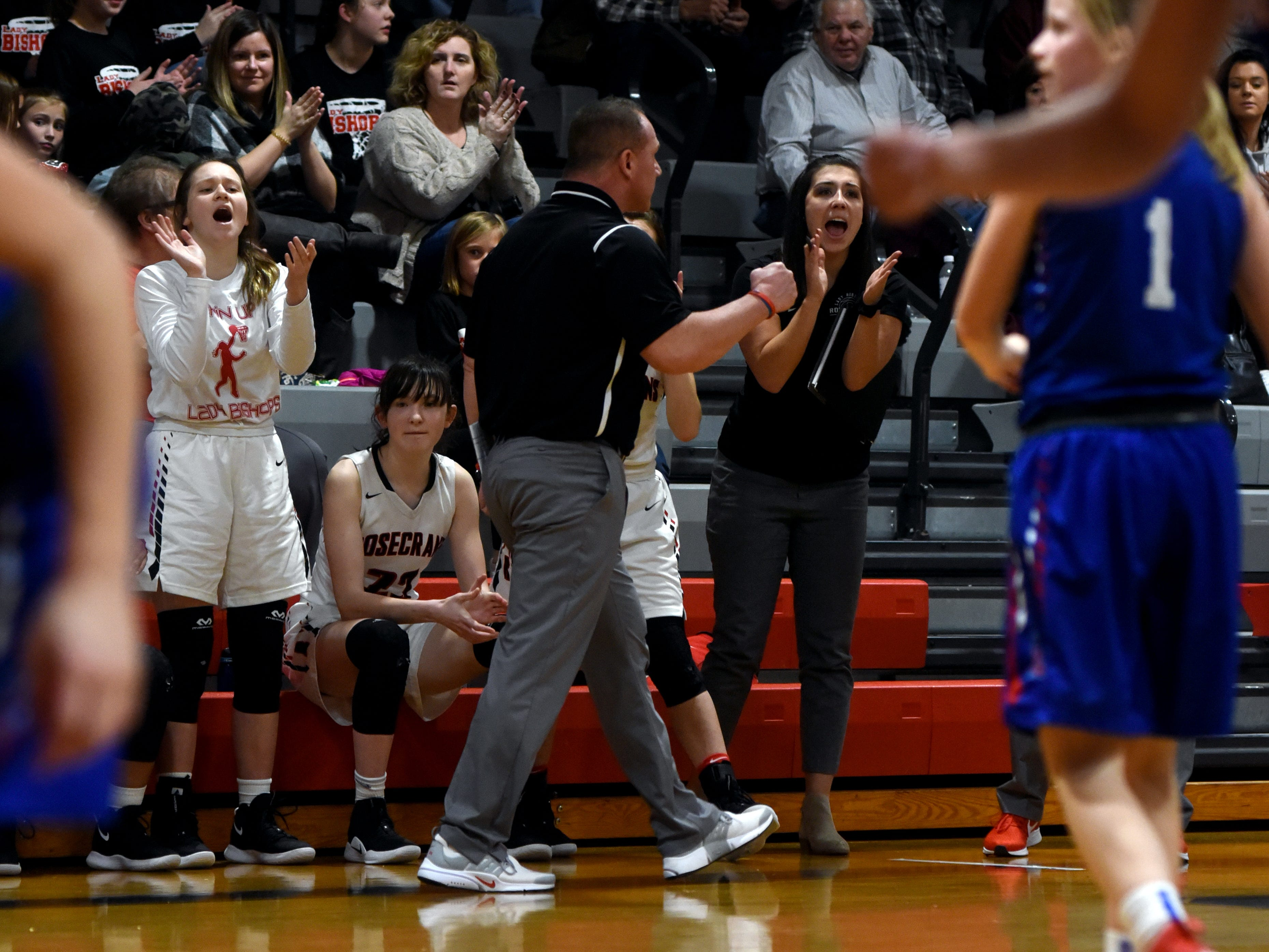 Rosecrans' bench celebrates Jenna Carlisle's three-point play in the fourth quarter on Monday night at Rogge Gymnasium.