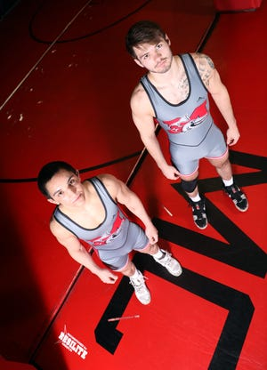 Muskingum University wrestlers Jordan Burkholder, left, and Tanner Walker, both hail from Perry County, and hope to represent the university at the NCAA Division III National Wrestling Tournament this spring.