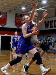 Lakewood's Bella Findlay is fouled on a fast break attempt by Rosecrans' Carley Roberts during the first half of their game on Monday night at Rogge Gymnasium. Rosecrans won, 47-44, to improve to 12-2.
