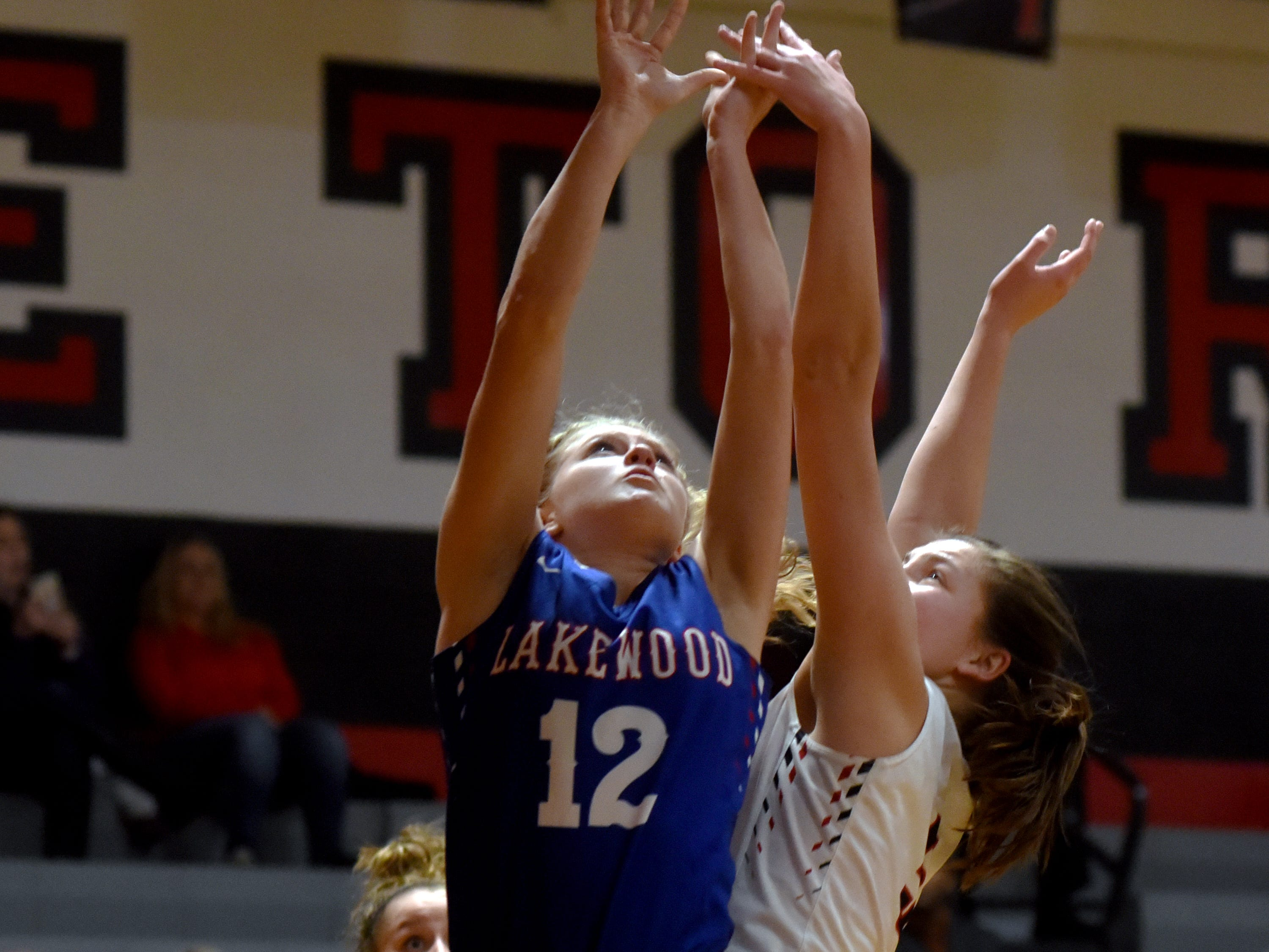Lakewood's Camryn Martindale goes up for a rebound with Rosecrans' Maggie Hutcheson on Monday night at Rogge Gymnasium. Rosecrans won, 47-44, to improve to 12-2 overall.