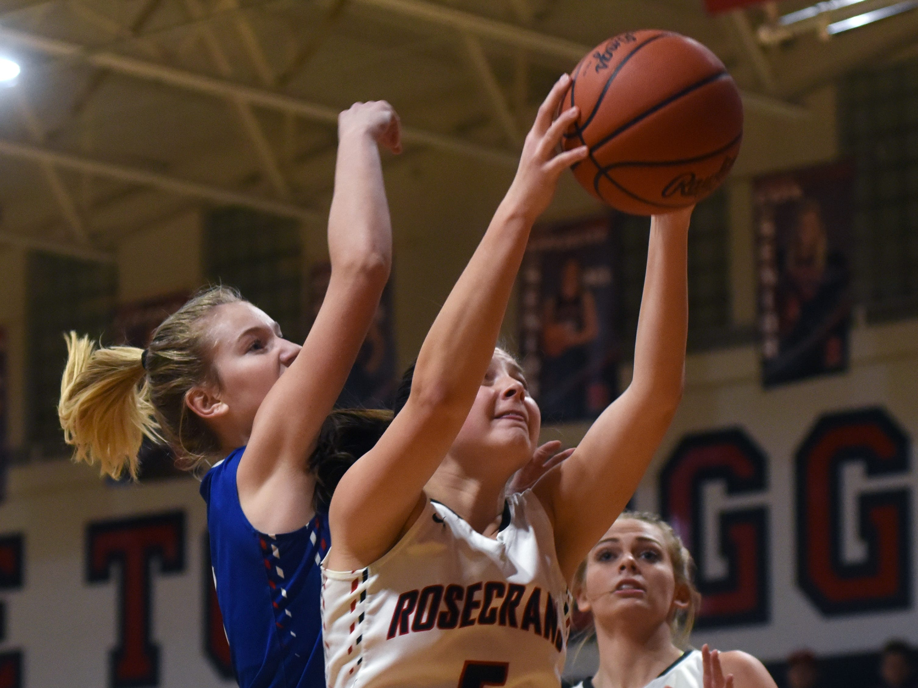 Maggie Hutcheson, of Rosecrans, pulls down a rebound against Lakewood on Monday night at Rogge Gymnasium.