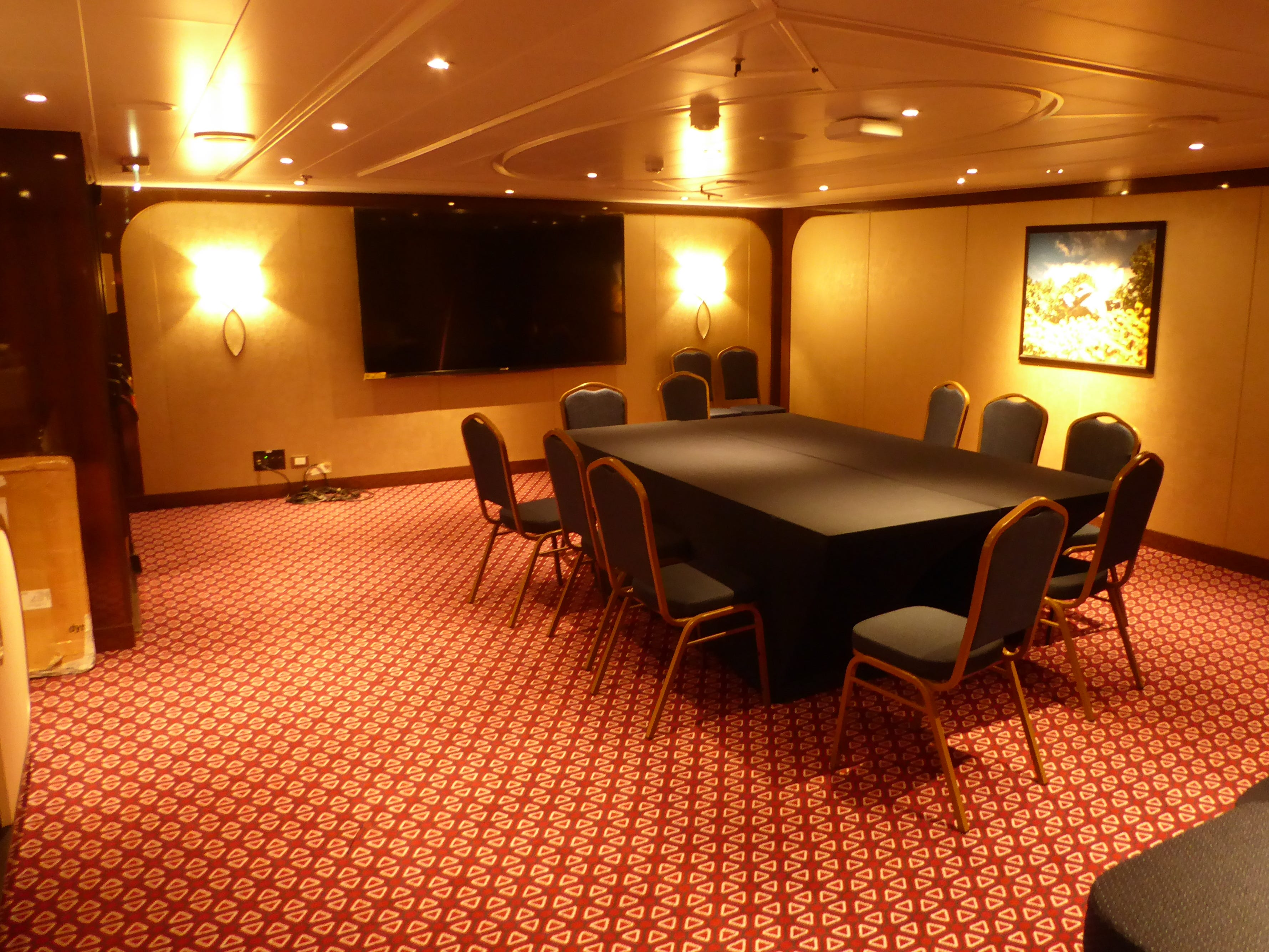A trio of meeting rooms are located off the Deck 1 level of the Atrium.  This is the 23-seat Stuyvesant Room.