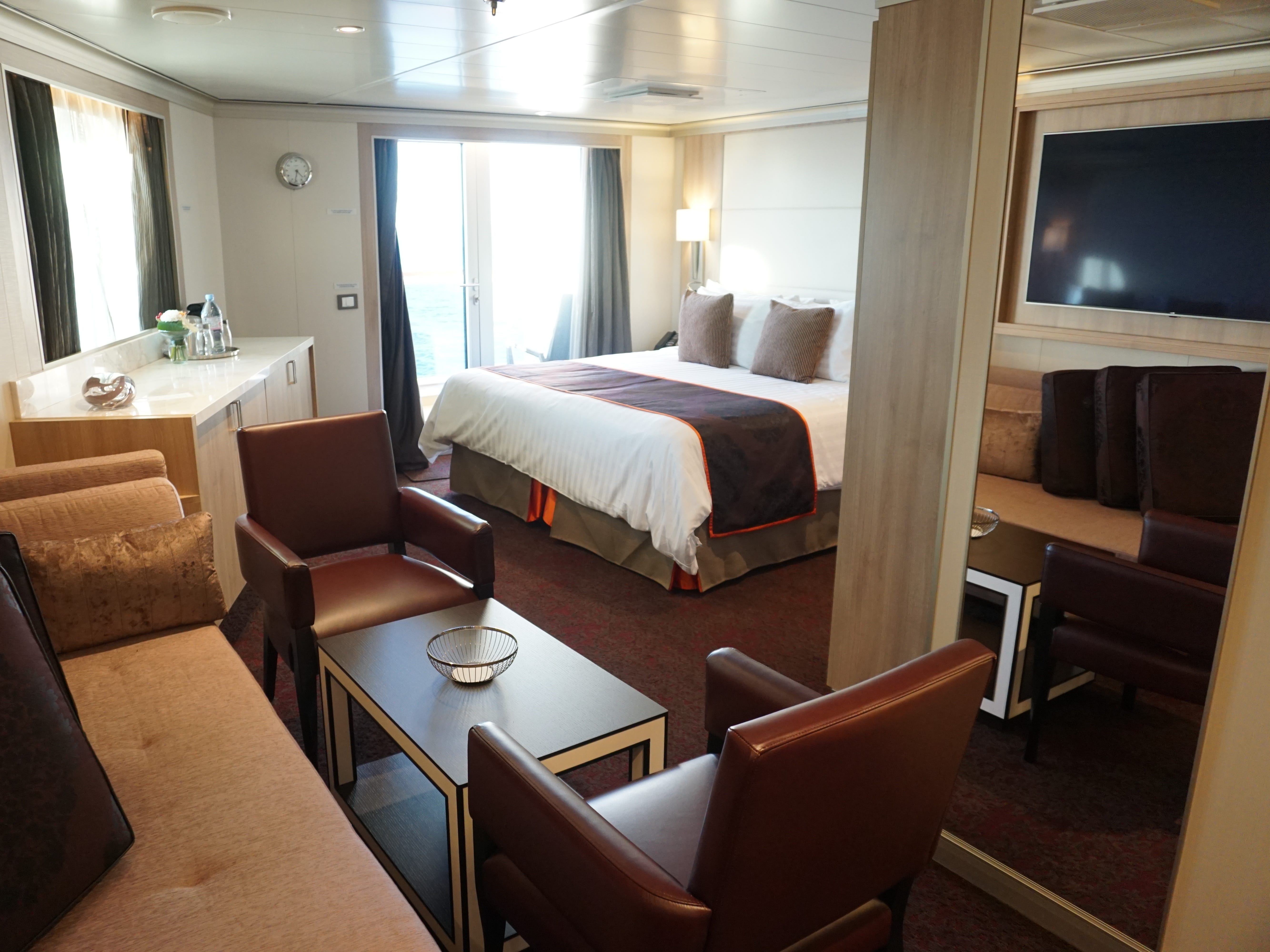 In the forward corners of Deck 5, there are large suites with a sitting area and separate bedroom.