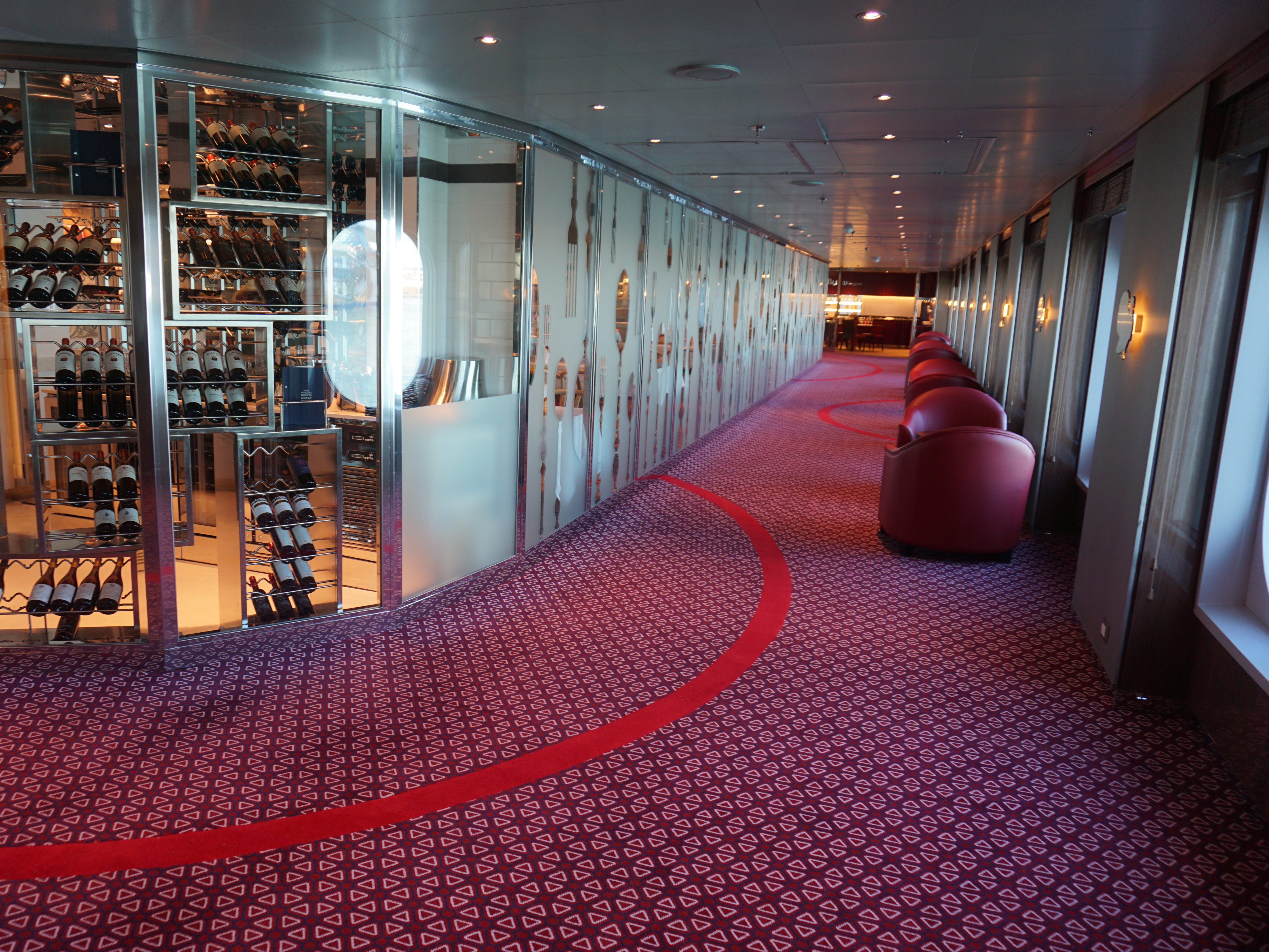 A wide passage with seating alcoves continues aft along the starboard side of Deck 2.