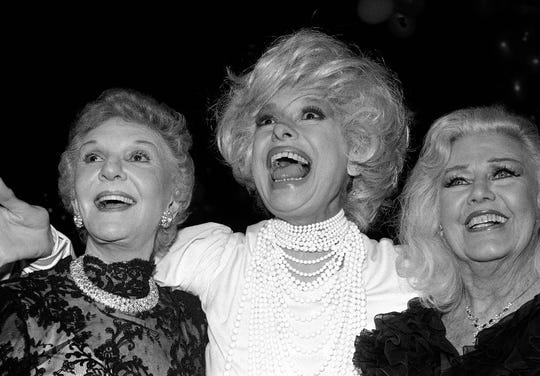 "Actress Carol Channing, center, joins Mary Martin, left, and Ginger Rogers, right, for a photograph at the Beverly Hilton Hotel in Beverly Hills, Calif., during a party for the cast and crew of the television series ""The Love Boat,"" April 1, 1985 (AP Photo/Liu Heung Shing)"