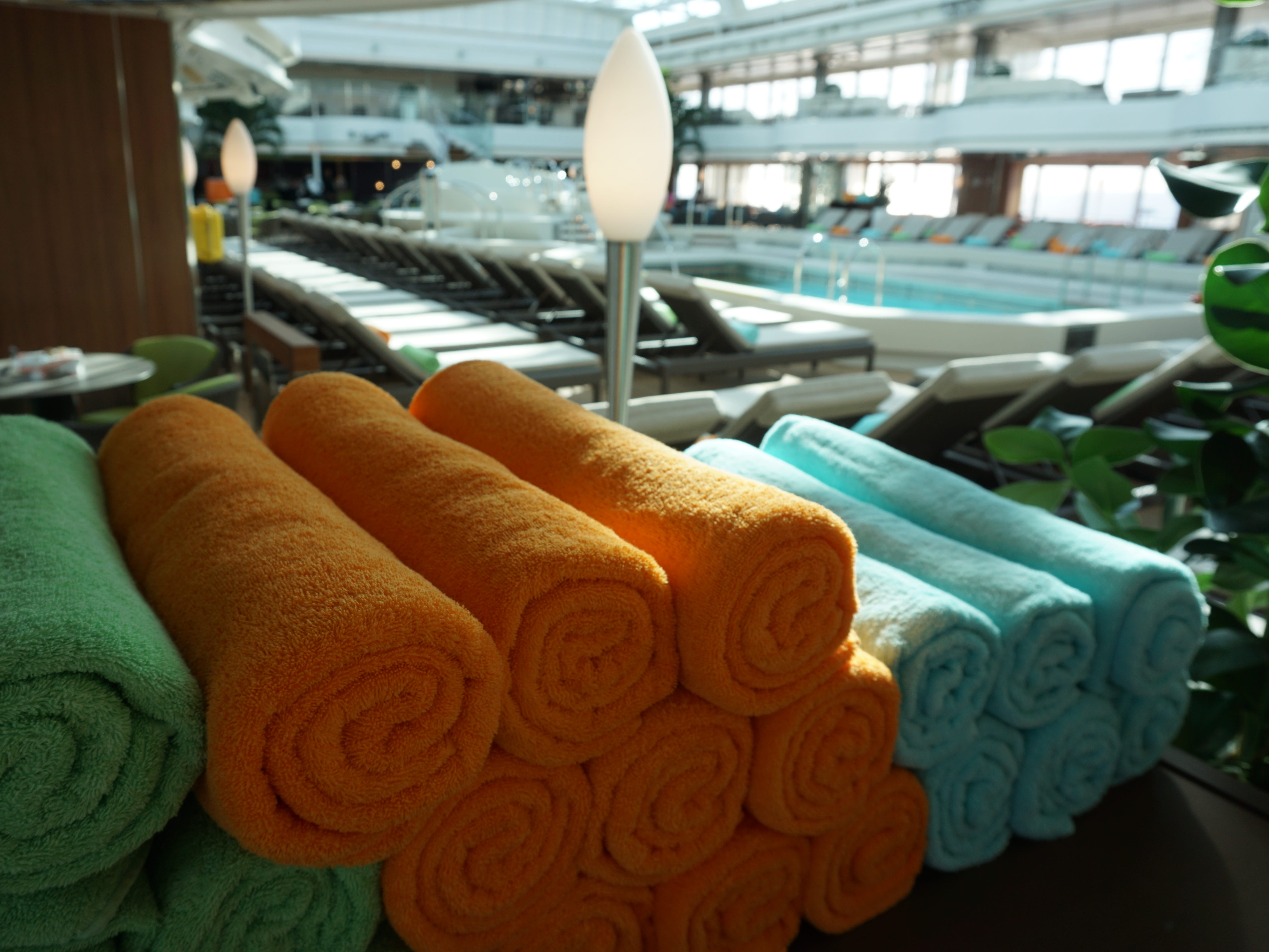 Colorful beach towels are provided at the midships Lido Pool on Deck 9.