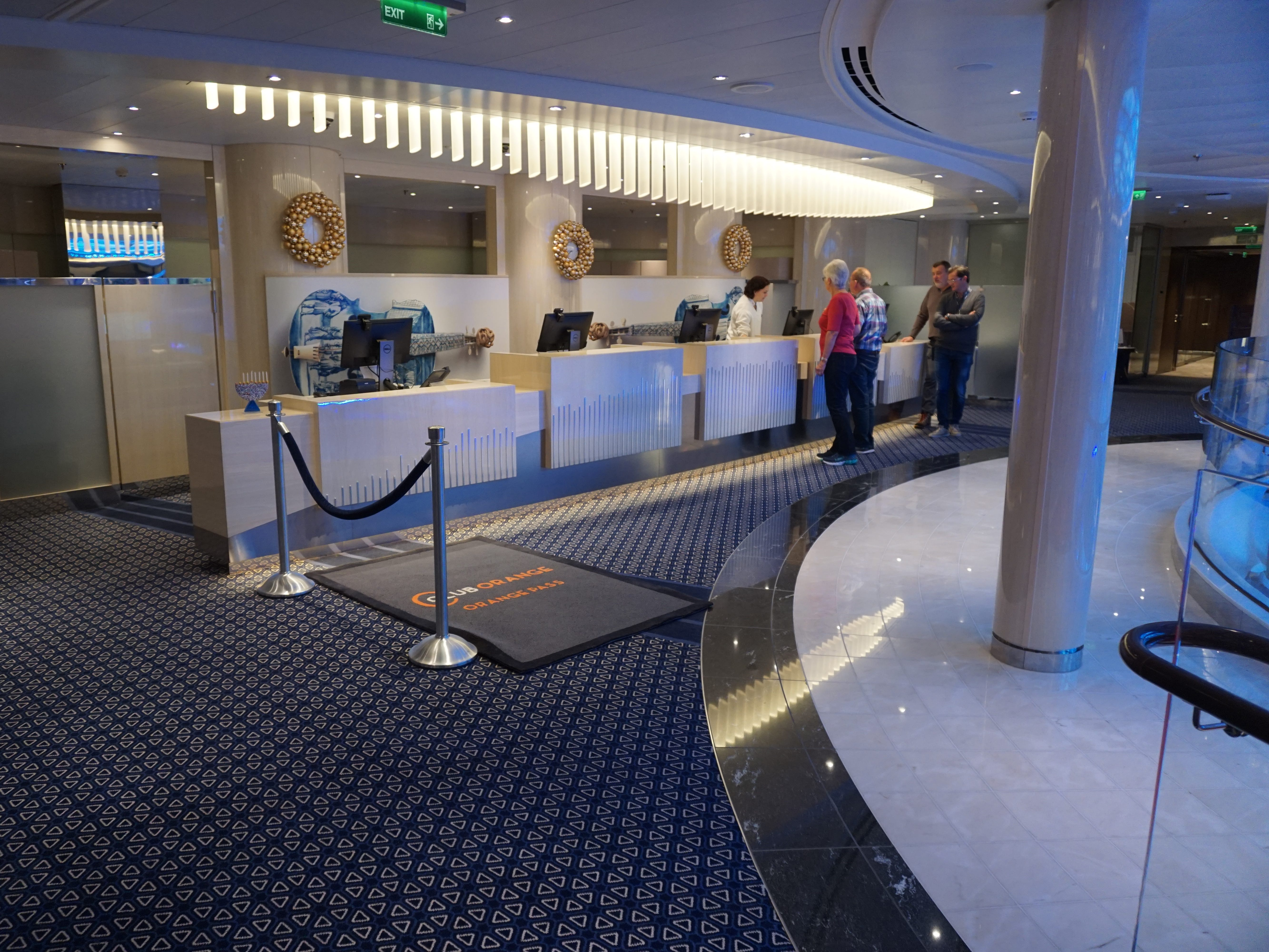 The Guest Services desk is located on the port side of the Atrium on Deck 3.