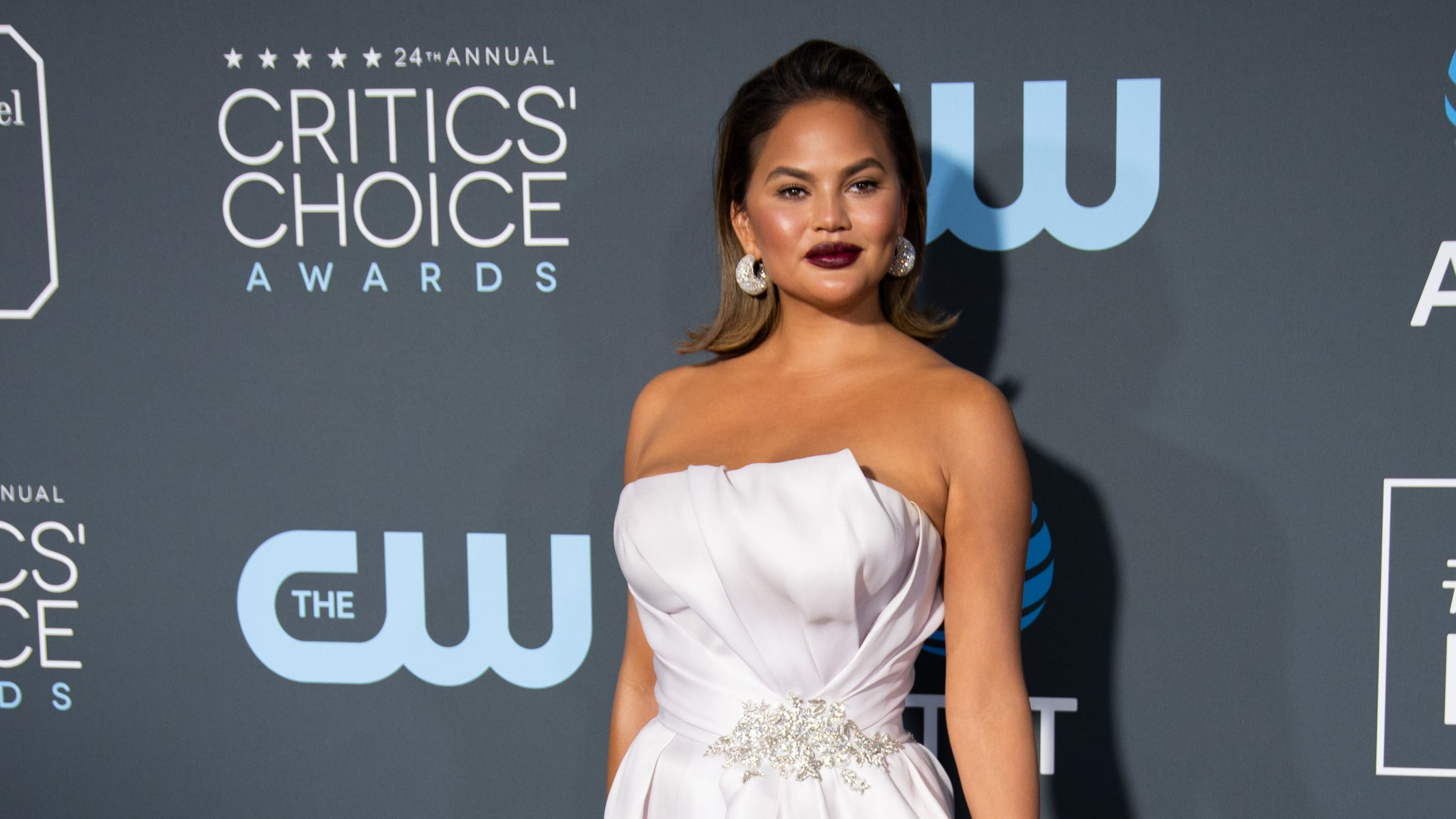 Chrissy Teigen says Luna and Miles helped her be 'very happy' with her body