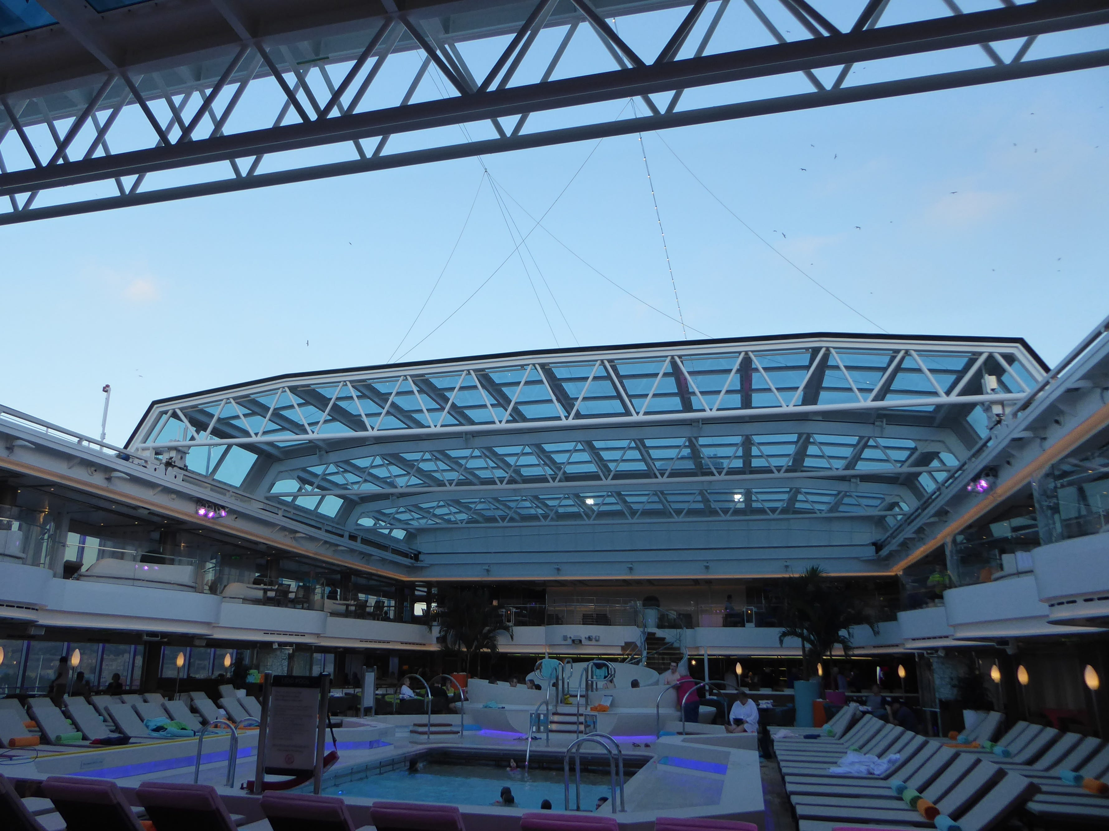 This is a view of the Deck 9 Lido Pool area with the sliding glass dome ajar.