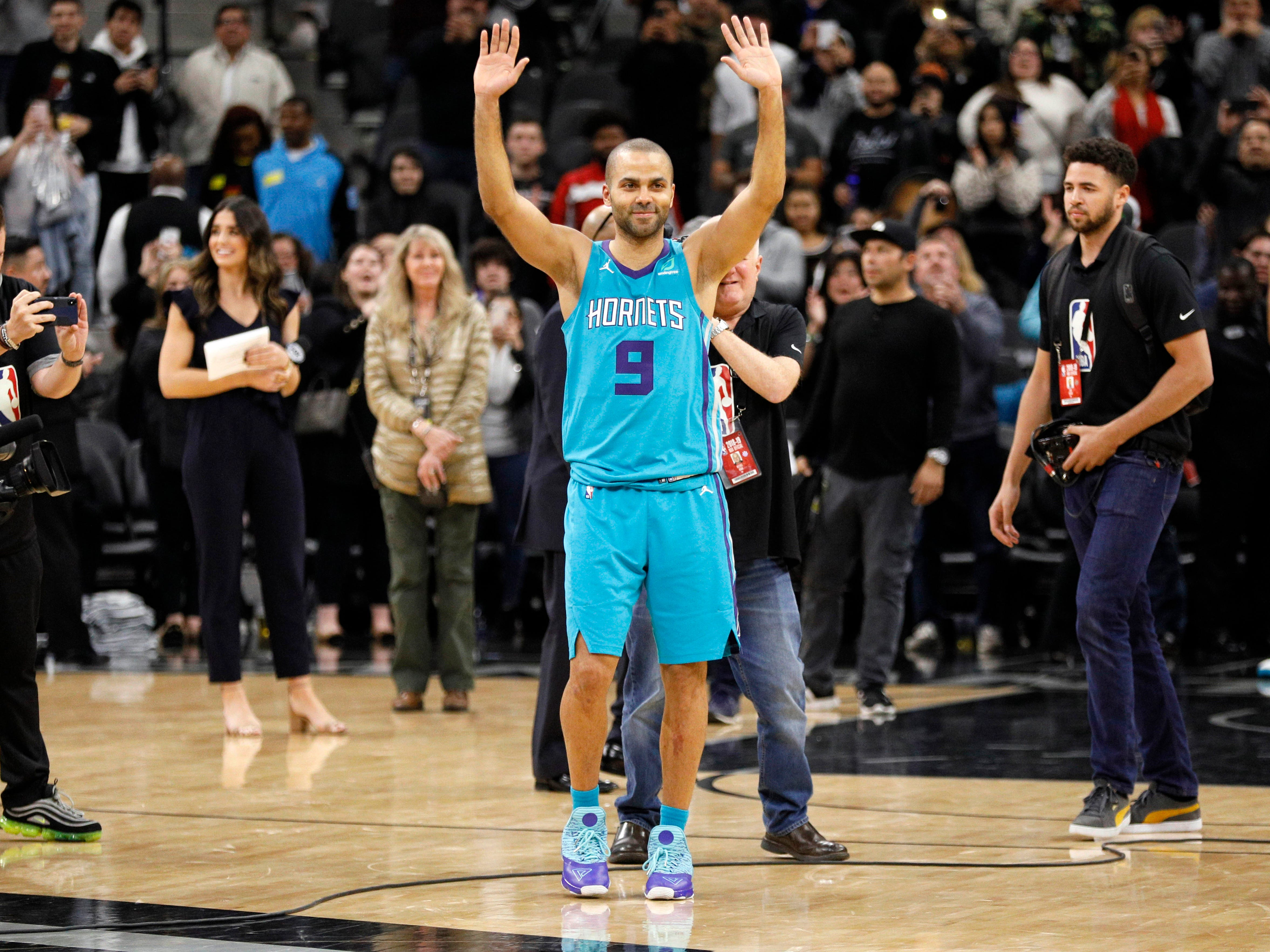 Jan. 14: Hornets guard Tony Parker waves to the crowd as he leaves the floor after the four-time champ's first game back in San Antonio as a member of the visiting team.