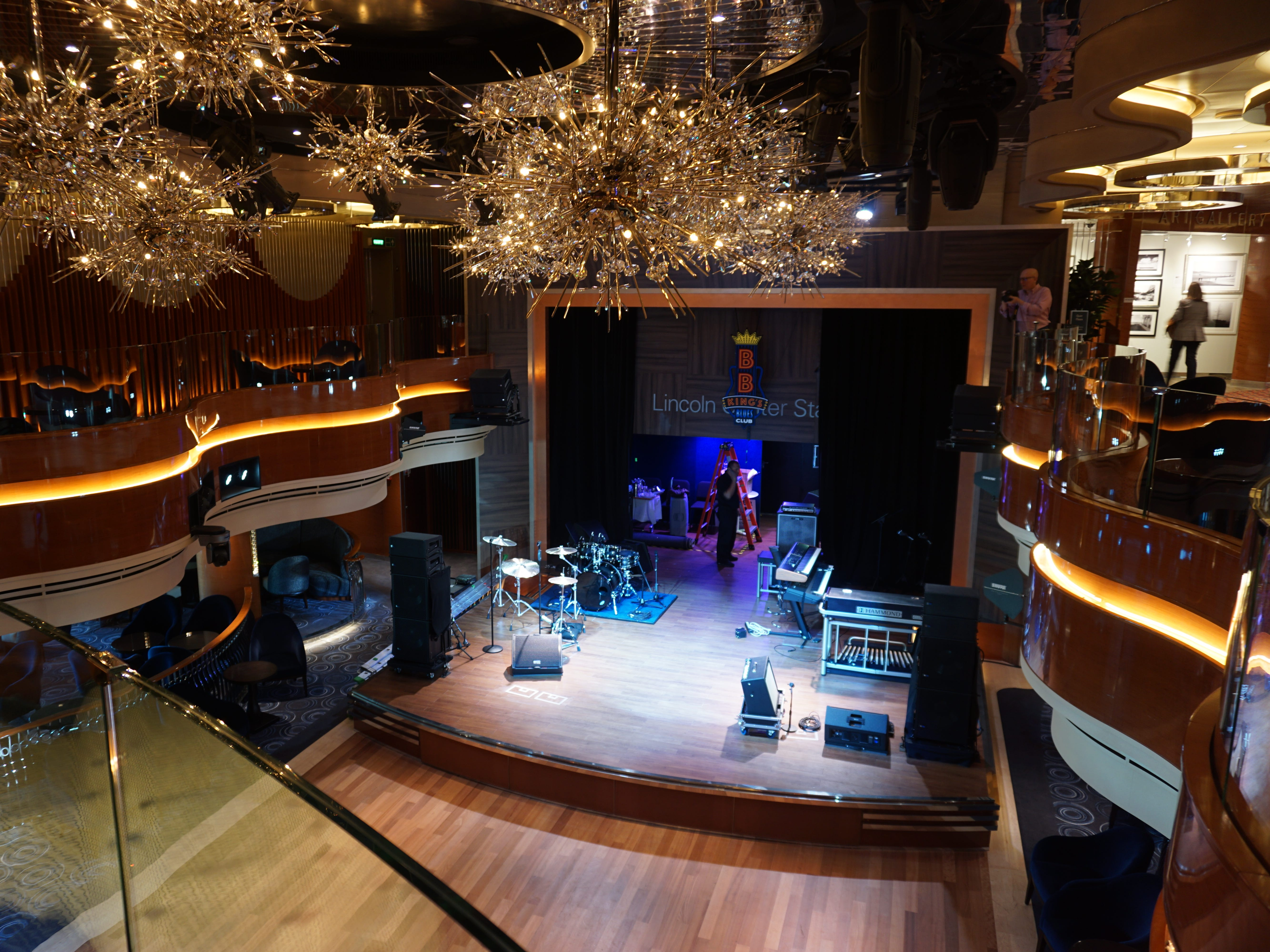 In the midst of the shopping area on Deck 3 is the upper level of the dual-purpose Lincoln Center Stage/BB King's entertainment venue.