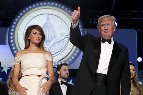 President Donald Trump and first lady Melania Trump thank guests during the inaugural Freedom Ball at the Washington Convention Center on Jan. 20, 2017, in Washington.