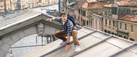 "Peter Parker (Tom Holland) gets all wet on a trip to Europe in ""Spider-Man: Far From Home."""