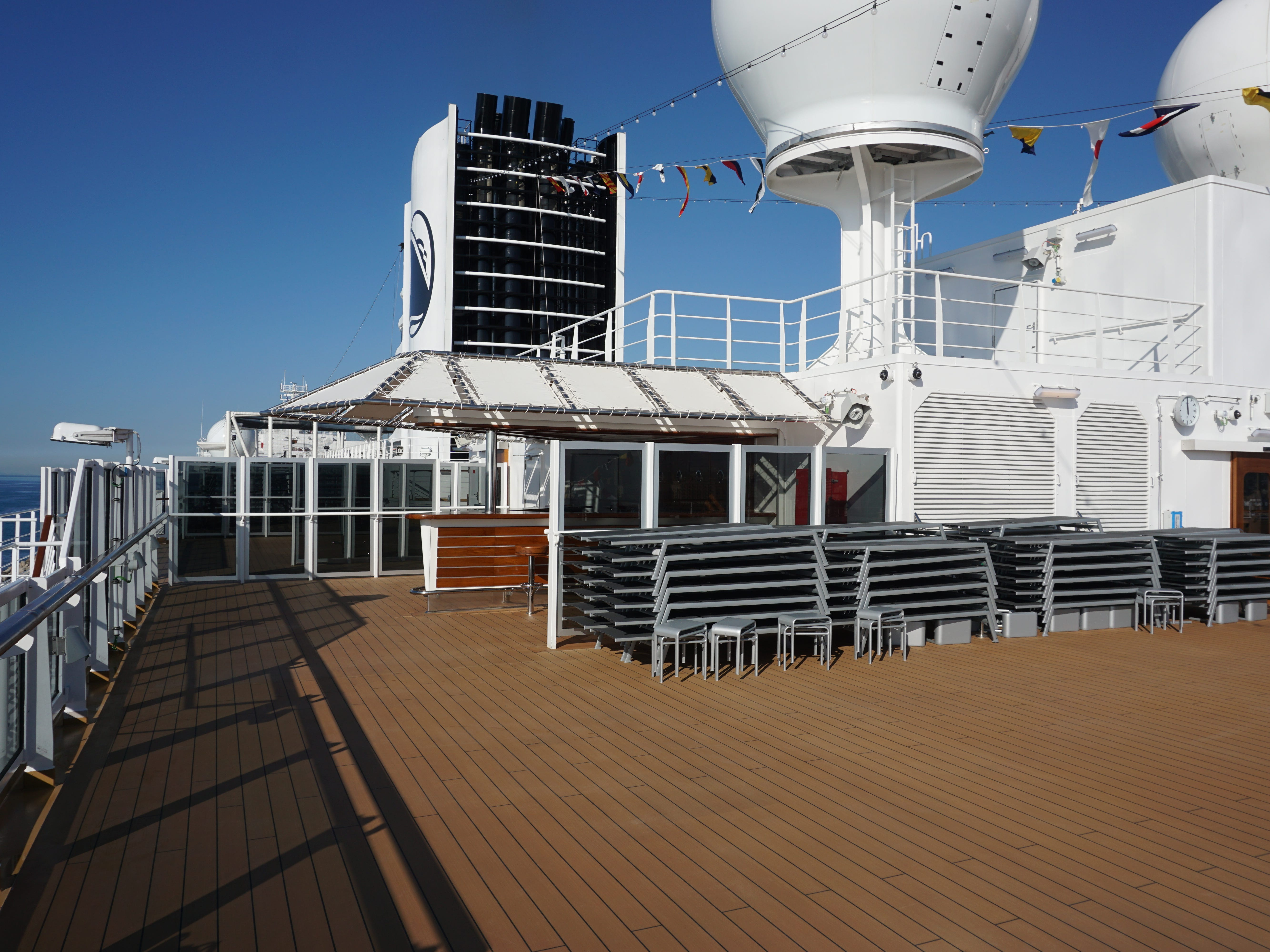 The Sun Bar and more sunning space can be found aft of the Sports Court and funnel on Deck 11.