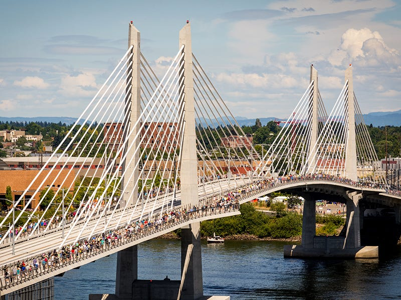 """Tilikum Crossing, Portland, Oregon: This bridge lives up to its nickname """"Bridge of the People"""" by banning personal cars. Only pedestrians, buses and trains may cross, promoting these environmentally friendly modes of transportation."""
