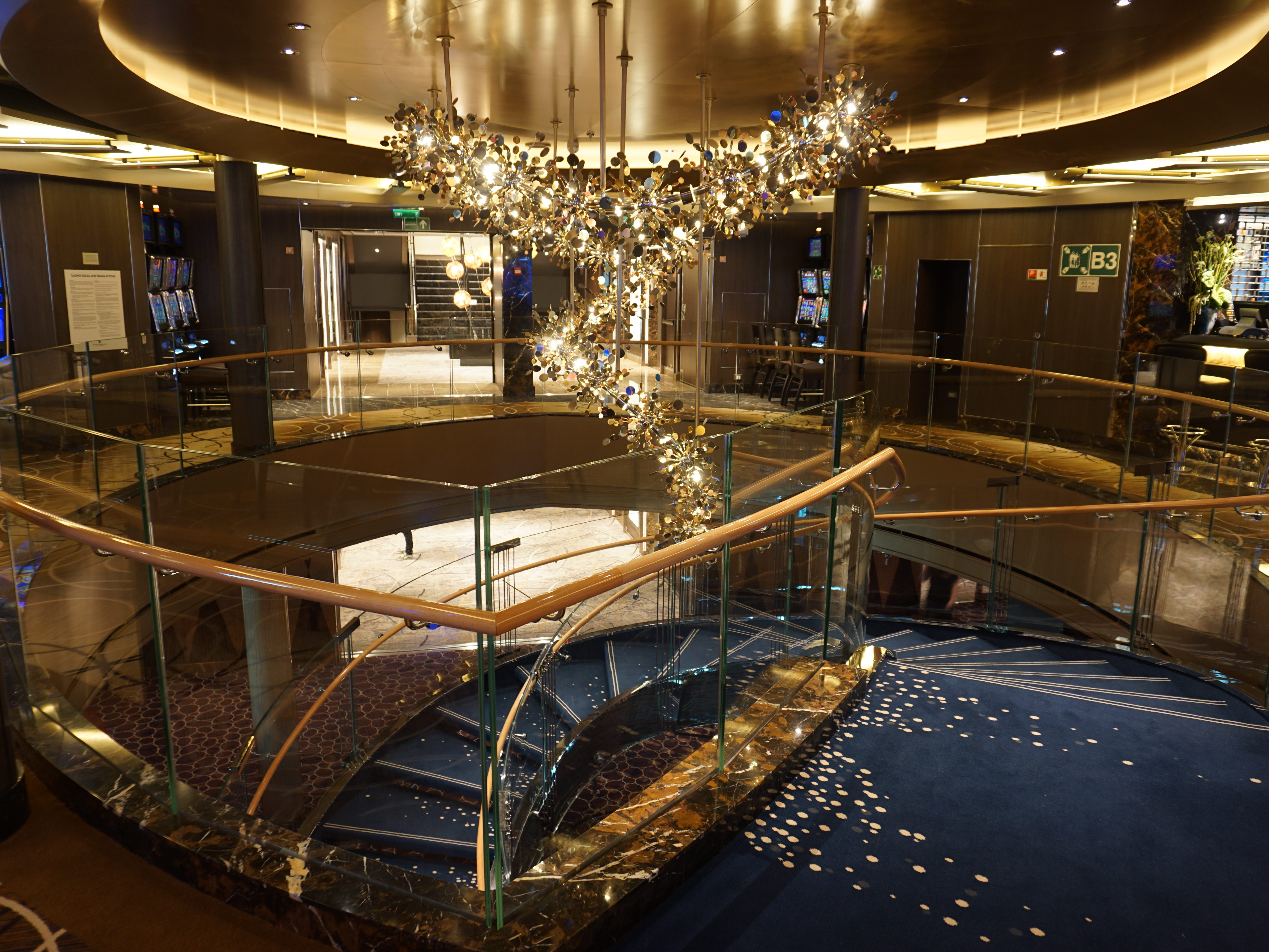 At the forward end of the Casino that follows the World Stage on Deck 3, there is a spiral staircase that connects with the Music Walk entertainment venues on Deck 2.