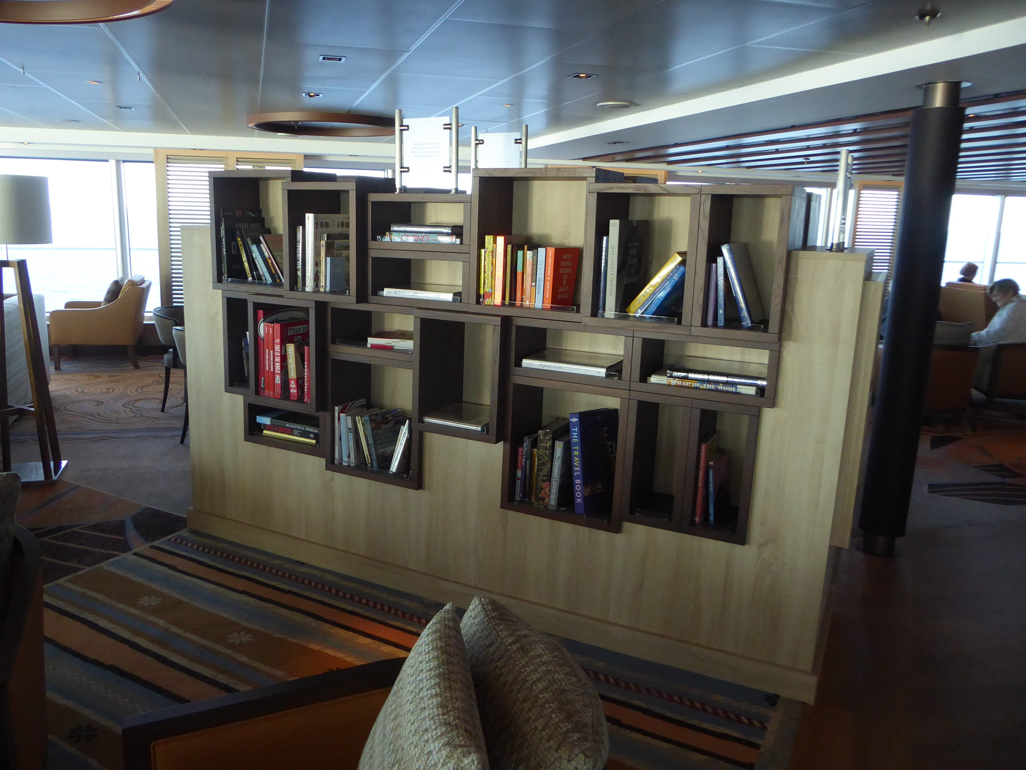 Shelves of books are located in Explorations Central and along the port-side passage leading into the lounge.