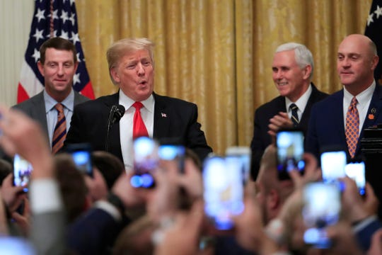 President Donald Trump is joined by (from left to right) Clemson head coach Dabo Swinney, Vice President Mike Pence and Clemson President James Clements.