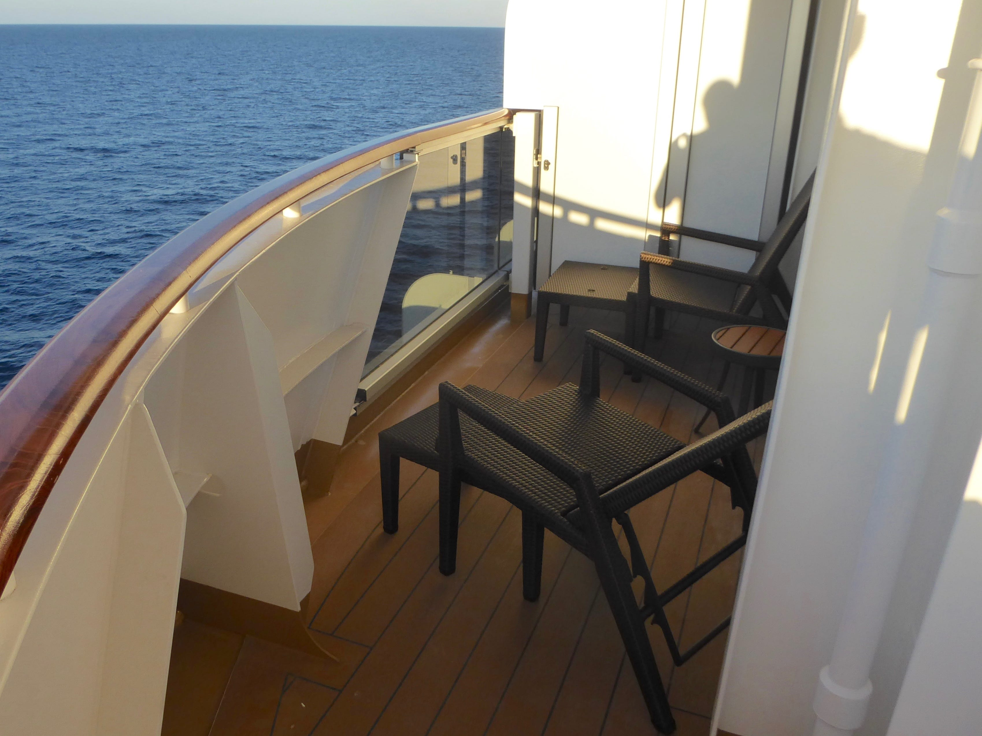 Suite 5001 on forward/starboard Deck 5 has a wrap-around balcony that peers over the ship's bow.