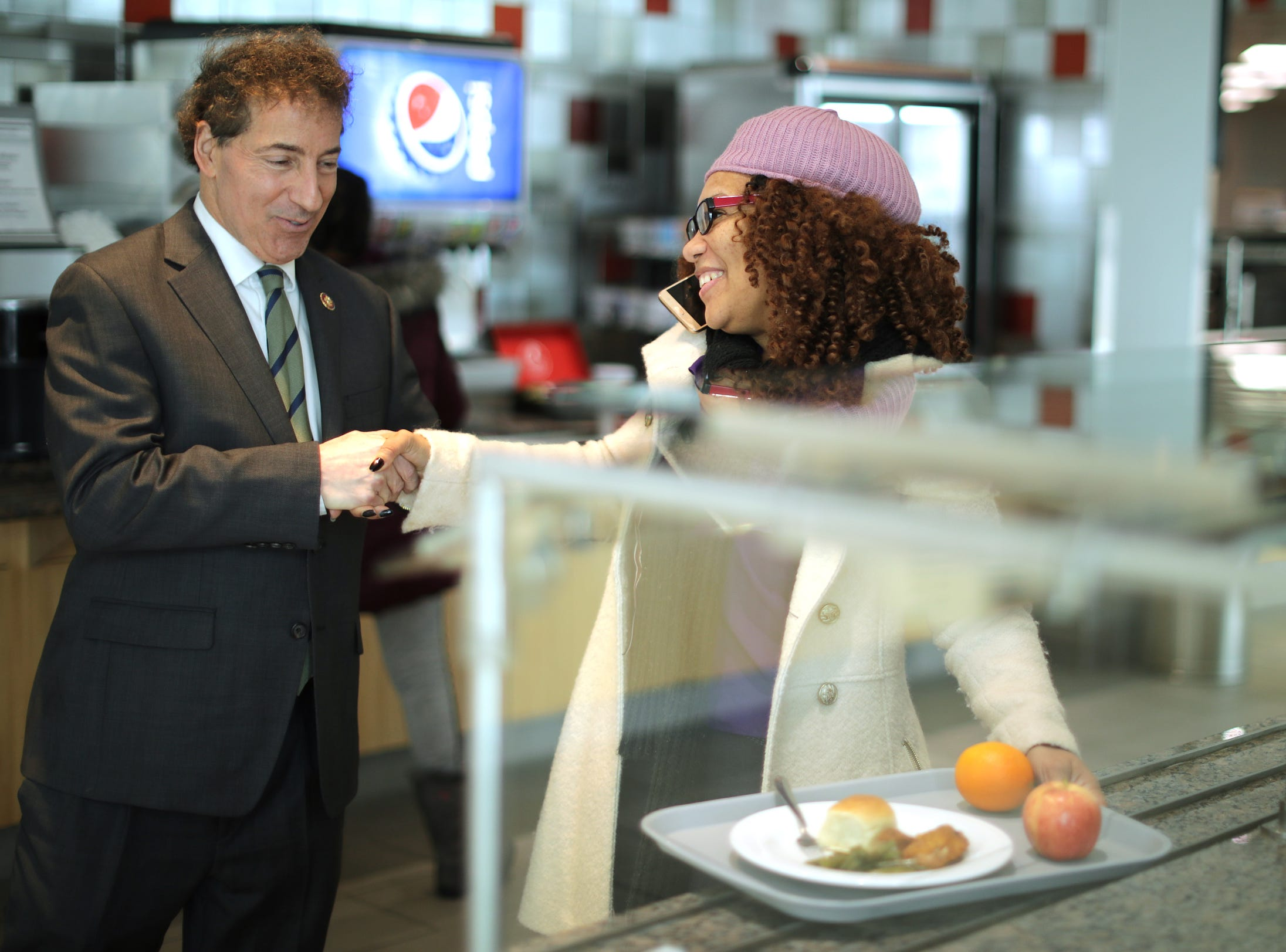Rep. Jamie Raskin (D-MD), left, greets Consumer Product Safety Commission employee Stacy Summerville as she gathered her lunch provided for furloughed federal workers and their families at the Tommy Douglas Conference Center in Silver Spring, MD, on Monday. The Amalgamated Transit Union will continue to offer meals for federal employees affected by the shutdown all week from 12 p.m. to 6 p.m.