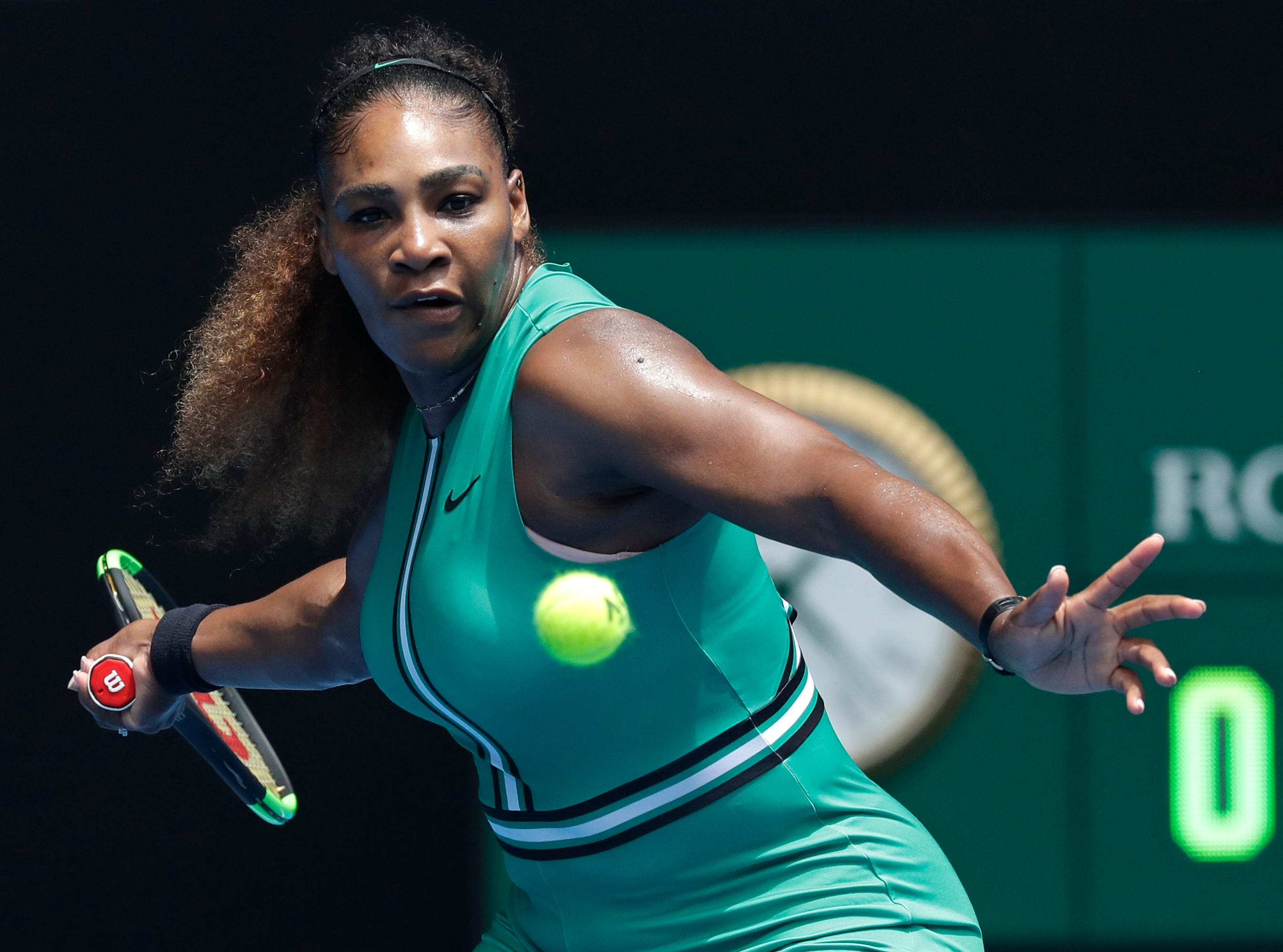 Serena Williams prepares to hit a forehand return to Germany's Tatjana Maria during their first round match at the Australian Open tennis championships in Melbourne, Australia, on Jan. 15.