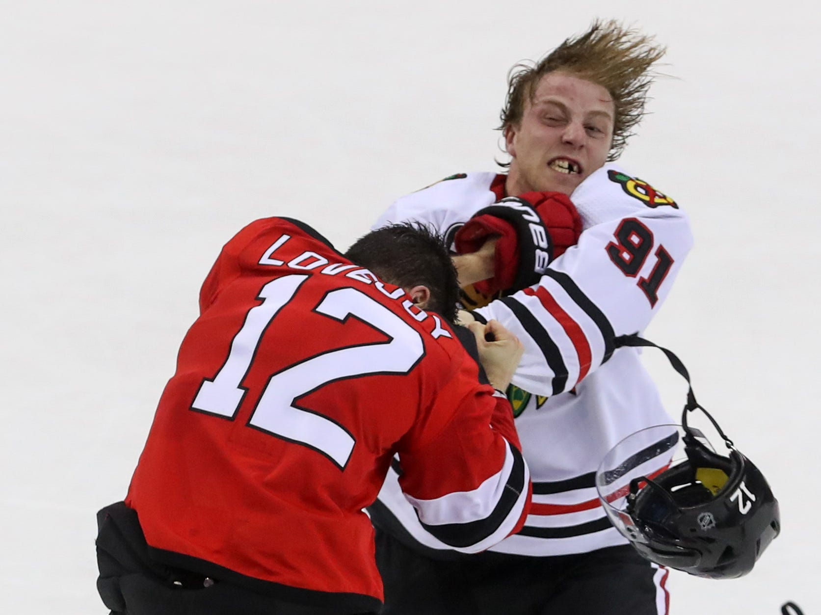 Jan. 14:  New Jersey Devils' Ben Lovejoy vs. Chicago Blackhawks' Drake Caggiula.
