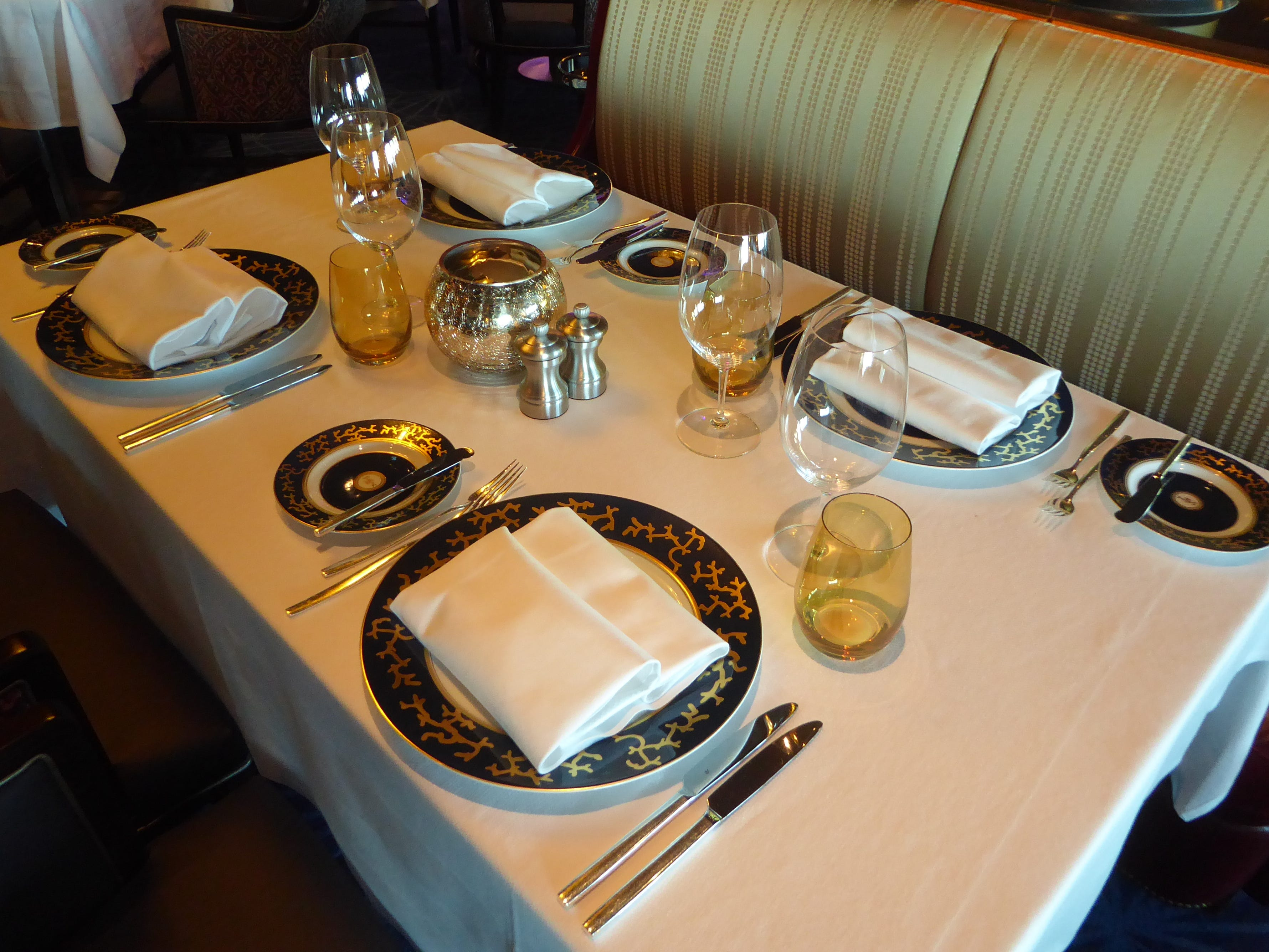 Table settings in the Pinnacle Grill feature Raynaud by Limoges china.