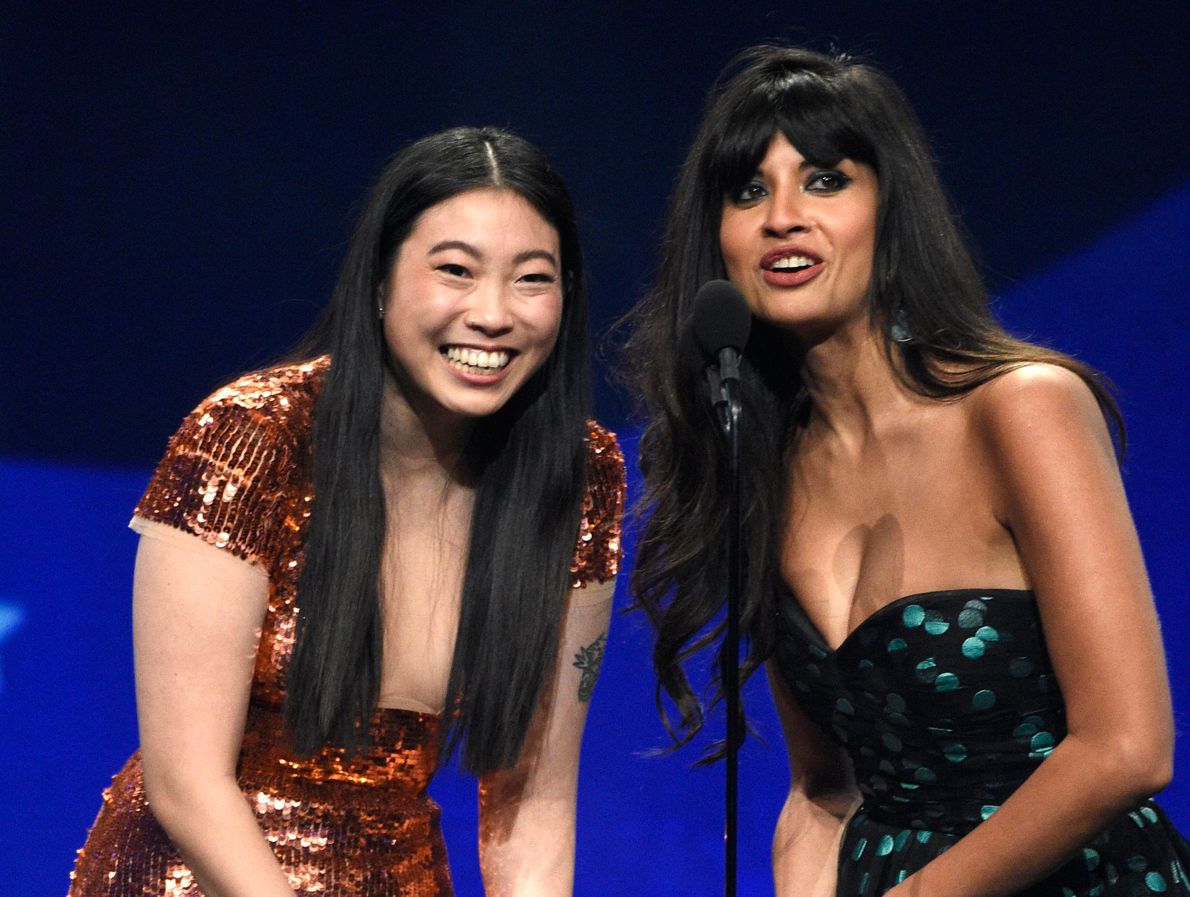 Awkwafina, left, and Jameela Jamil present the award for best actress in a drama series at the 24th annual Critics' Choice Awards on Sunday, Jan. 13, 2019, at the Barker Hangar in Santa Monica, Calif. (Photo by Chris Pizzello/Invision/AP) ORG XMIT: CAPM465