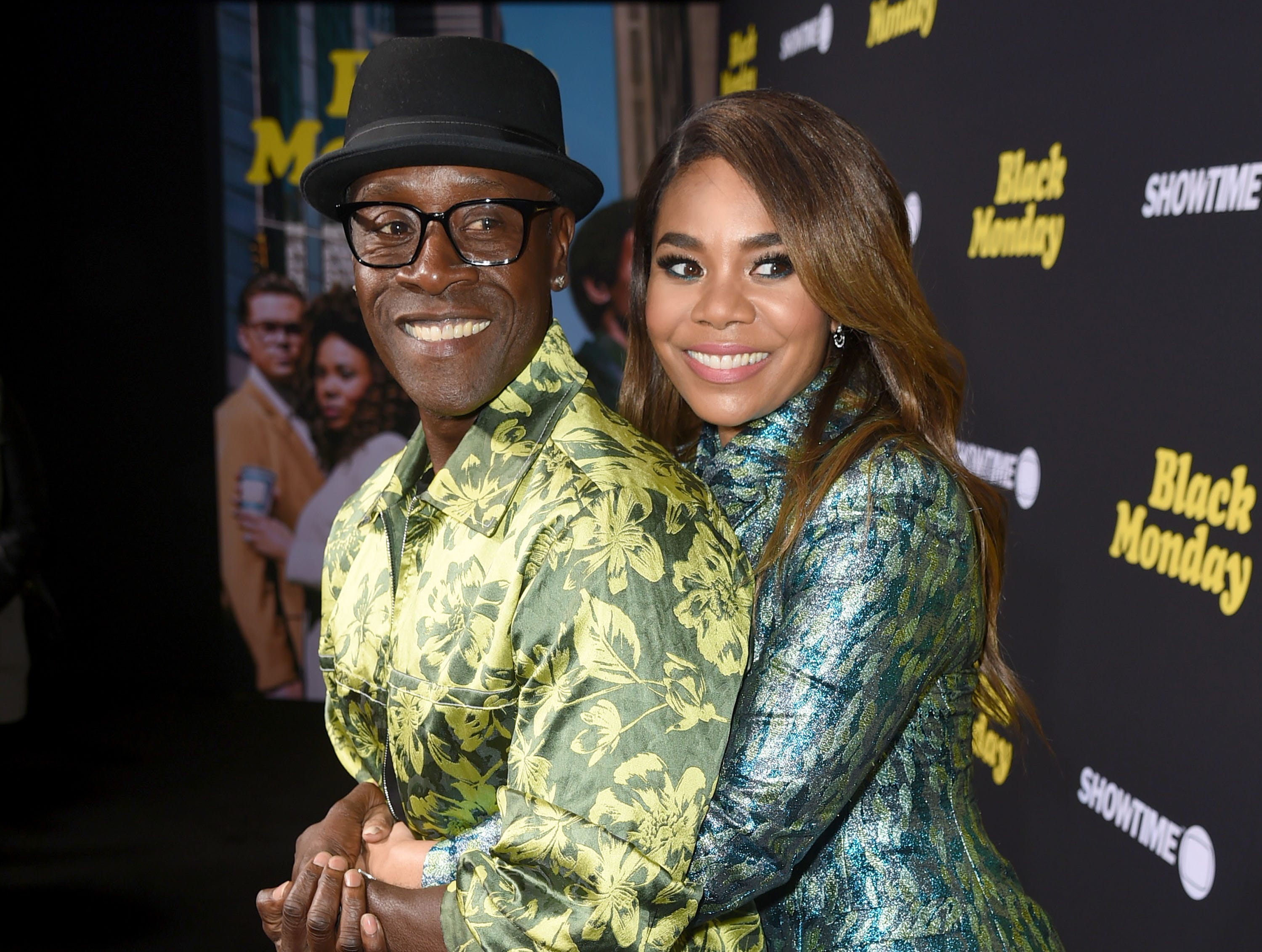 "LOS ANGELES, CALIFORNIA - JANUARY 14: Don Cheadle and Regina Hall arrive at the premiere of Showtime's ""Black Monday"" at The Theatre at Ace Hotel on January 14, 2019 in Los Angeles, California. (Photo by Kevin Winter/Getty Images) ORG XMIT: 775273619 ORIG FILE ID: 1094400498"