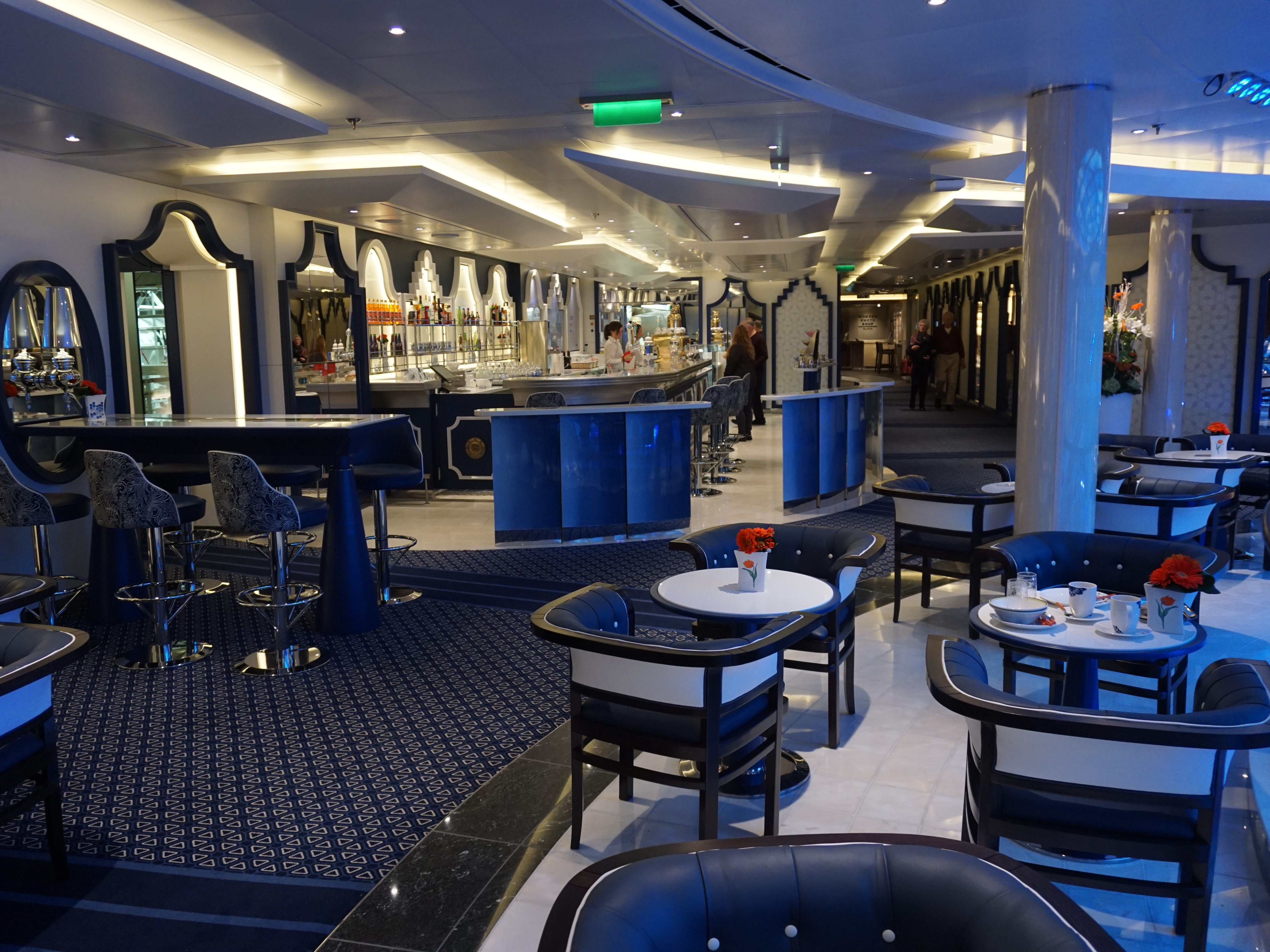 The Grand Dutch Cafe is a specialty coffee shop with Dutch-inspired treats for sale overlooking the starboard side of the Atrium on Deck 3.