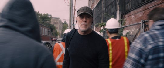 "David Dunn (Bruce Willis) protects the streets of Philadelphia in ""Glass."""