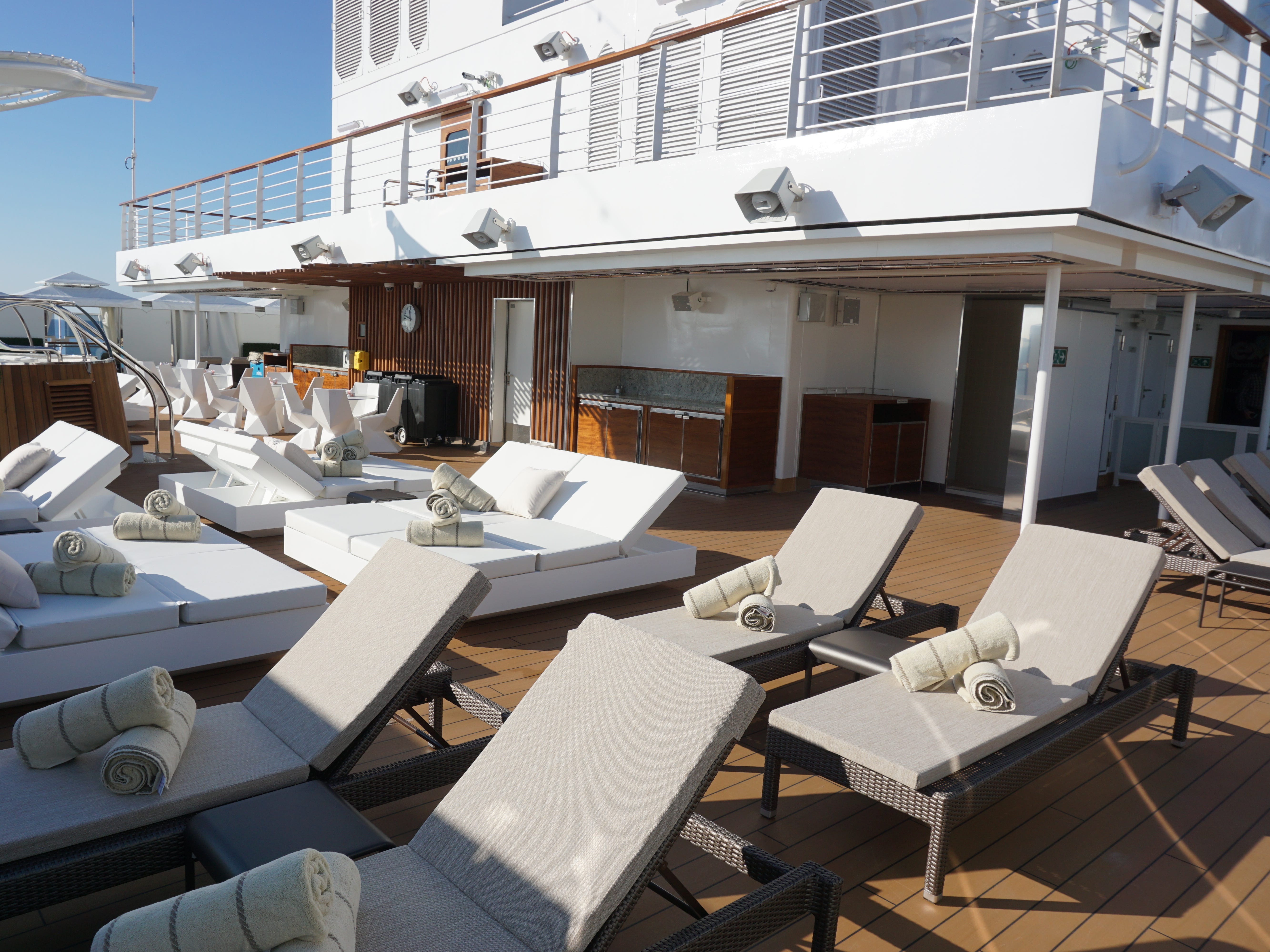 The Retreat is on the next level, Deck 12 (there is no Deck 13). It features open sunning space, a Jacuzzi and private cabanas for rent.
