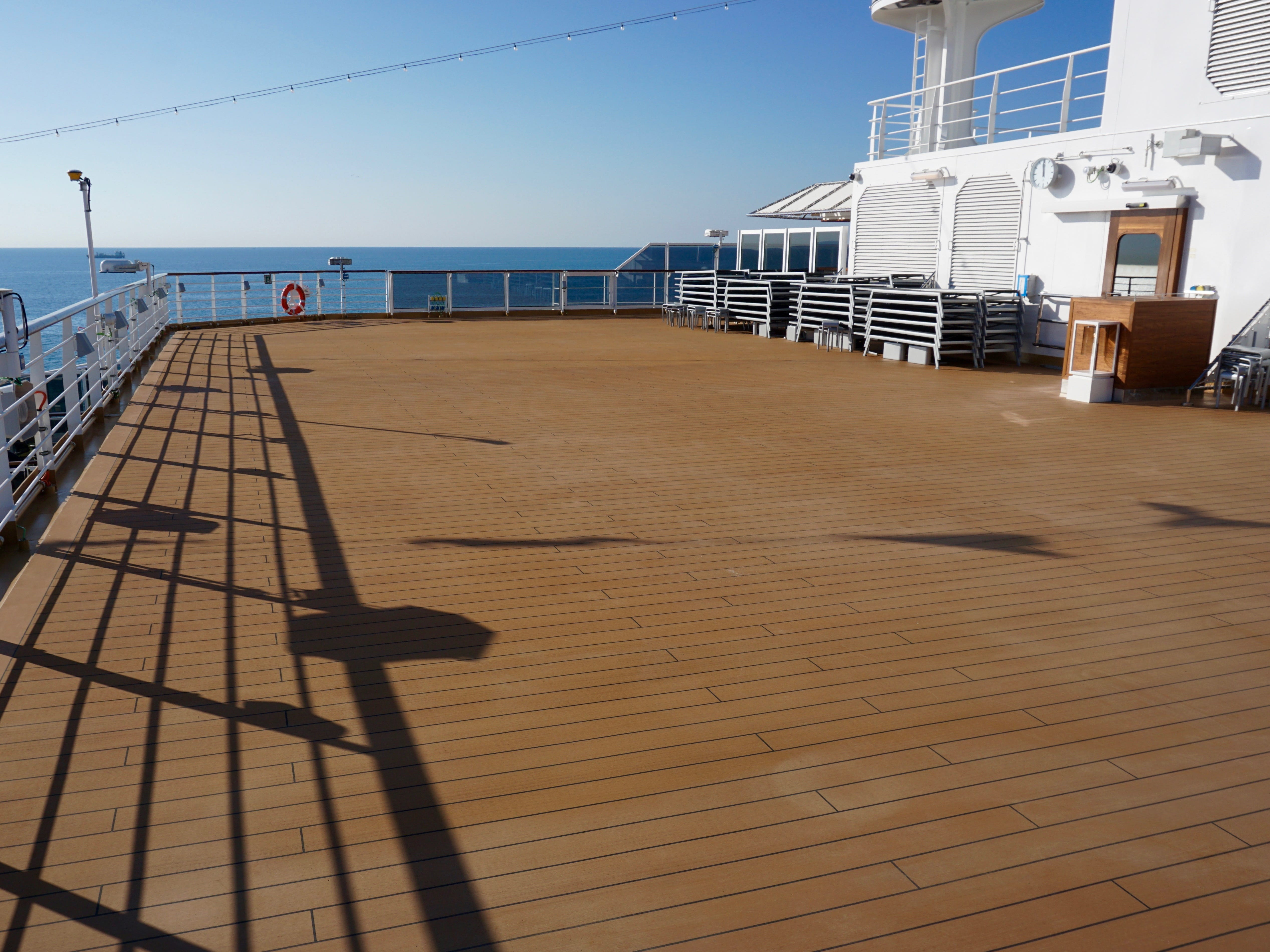 The far aft portion of Deck 11 features an open platform that overlooks the ship's stern.