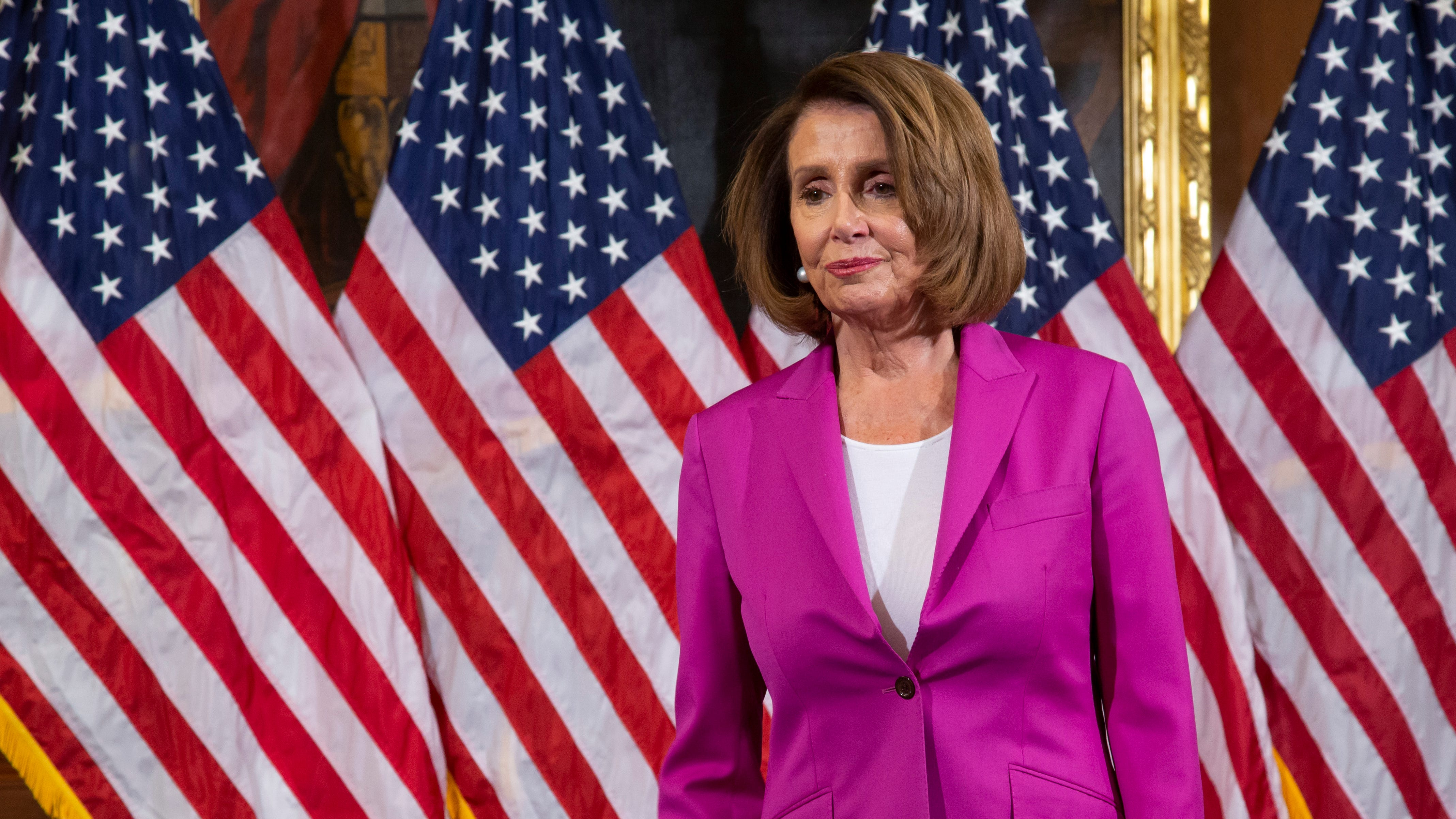 Speaker of the House Nancy Pelosi, D-Calif., waits for her new committee chairs to assemble for a formal photo at the Capitol in Washington, Friday, Jan. 11, 2019. (AP Photo/J. Scott Applewhite) ORG XMIT: DCSA109