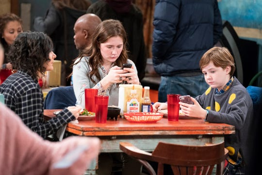 Darlene Conner (Sara Gilbert), left, has trouble getting the attention of her children, Harris (Emma Kenney) and Mark (Ames McNamara), when she's trying to tell them she may be getting into a serious relationship on ABC's 'The Conners.'