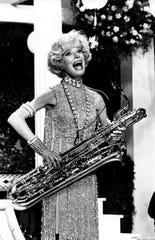 "Carol Channing sings and plays the bass saxophone in a scene from the movie ""Thoroughly Modern Millie"" during rehearsal in Hollywood, Ca., on Nov. 17, 1966. (AP Photo)"