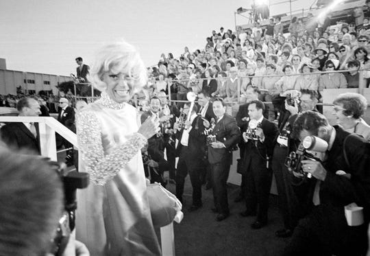 "Carol Channing arrives for the 1967 Academy Awards ceremony at the Santa Monica Civic Auditorium in Santa Monica, Ca., on April 10, 1968.  Channing is nominated for best actress in a supporting role for ""Thoroughly Modern Millie.""  (AP Photo)"