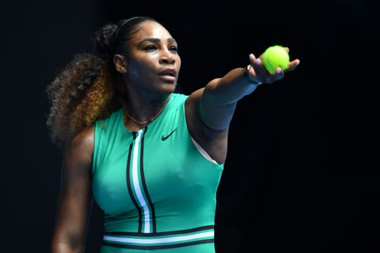 Serena Williams serves against Germany's Tatjana Maria during their women's singles match at the Australian Open on Jan. 15. Williams won in straight sets.