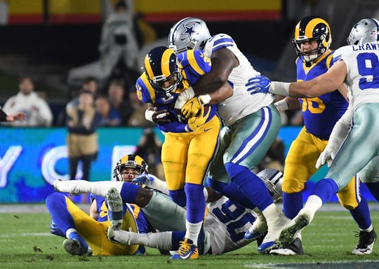 Dallas Cowboys defensive tackle Maliek Collins (96) tackles Los Angeles Rams running back Todd Gurley (30) in the first quarter in a NFC Divisional playoff football game at Los Angeles Memorial Coliseum.