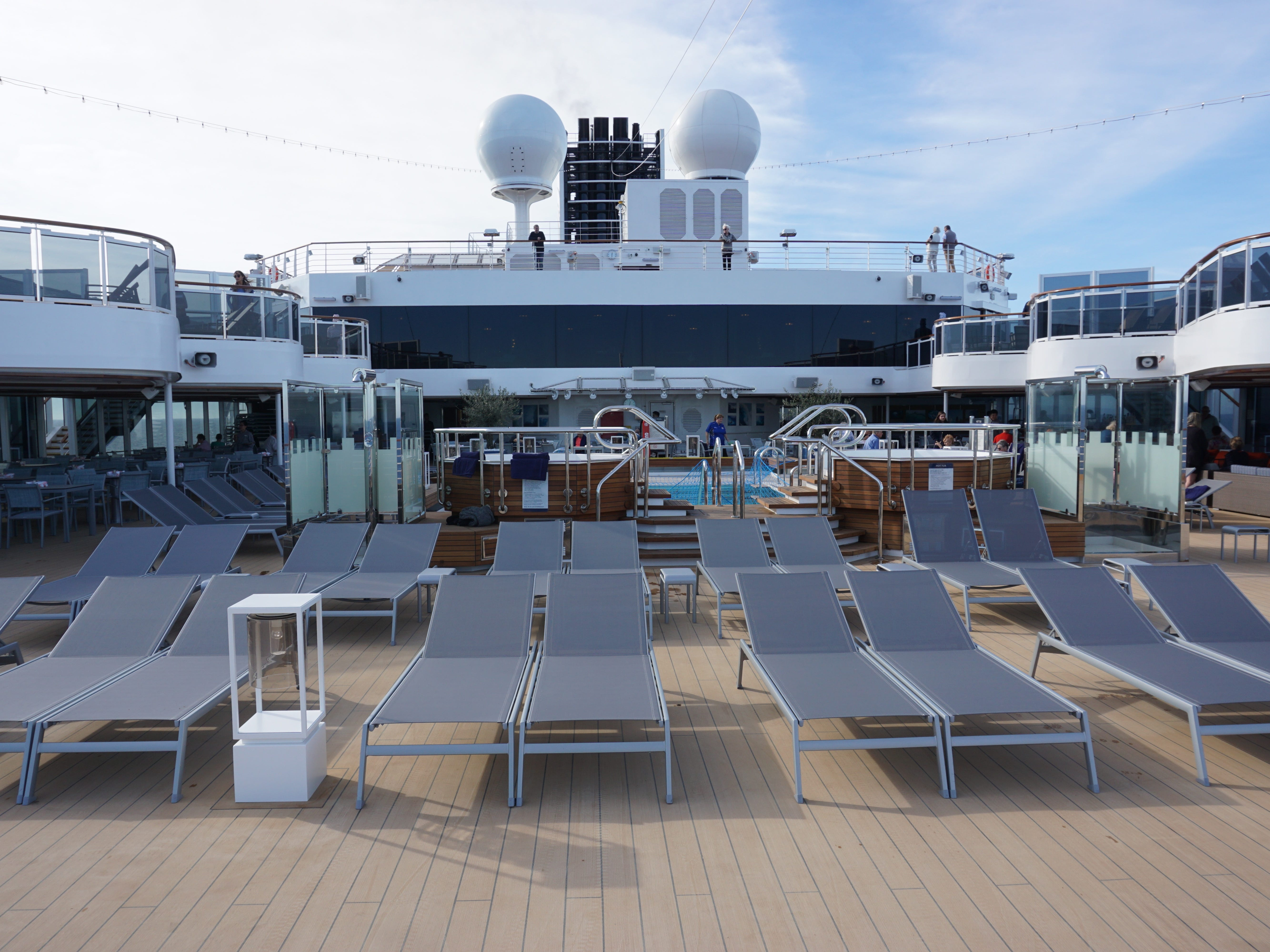 Open and sheltered space surrounds the Sea View Pool at the aft end of Deck 9.